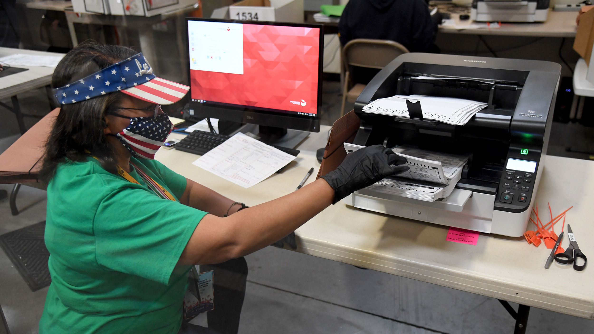 A Clark County election worker scans mail-in ballots on November 7 in North Las Vegas, Nevada.