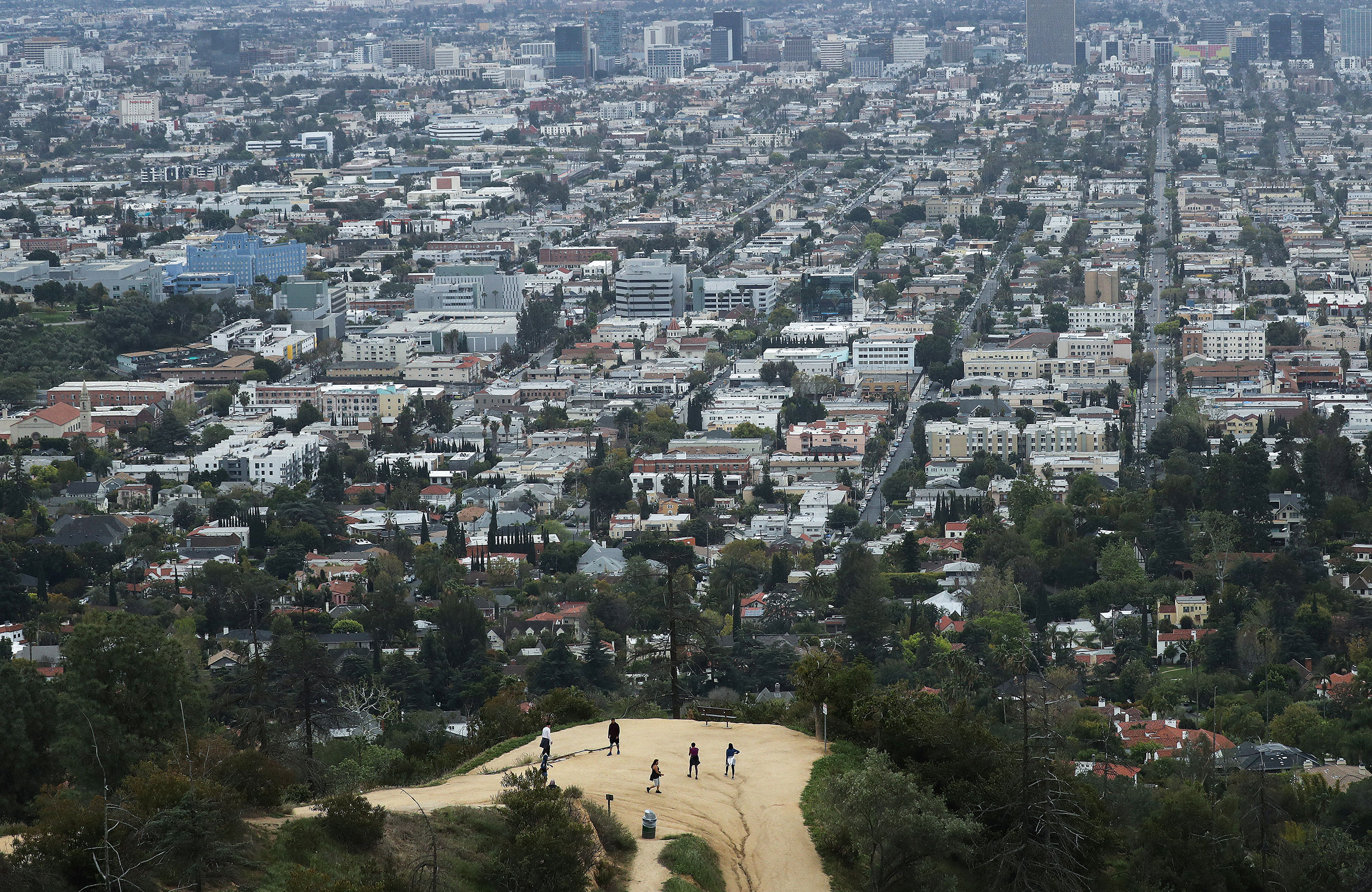 People gather on a hiking trail at Griffith Park in Los Angeles, California, on March 22.