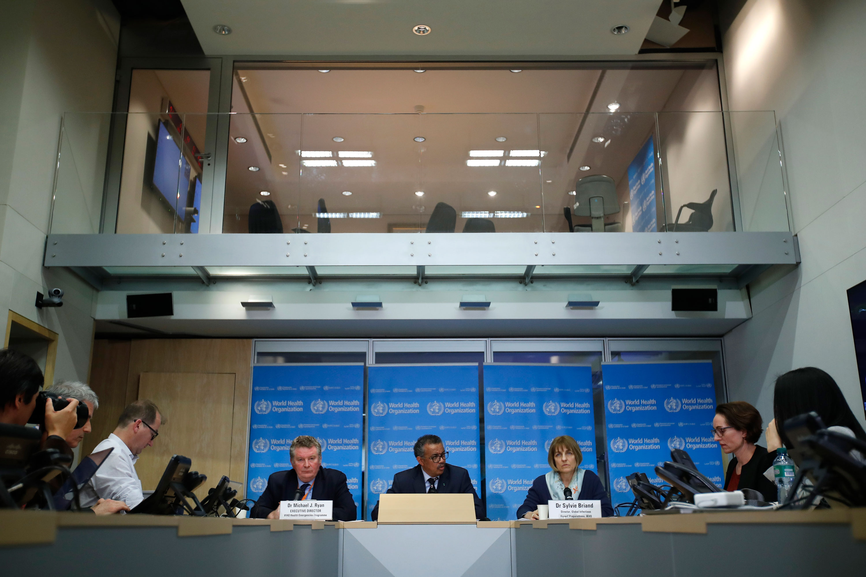 Officials with the World Health Organization talk to reporters on Tuesday.