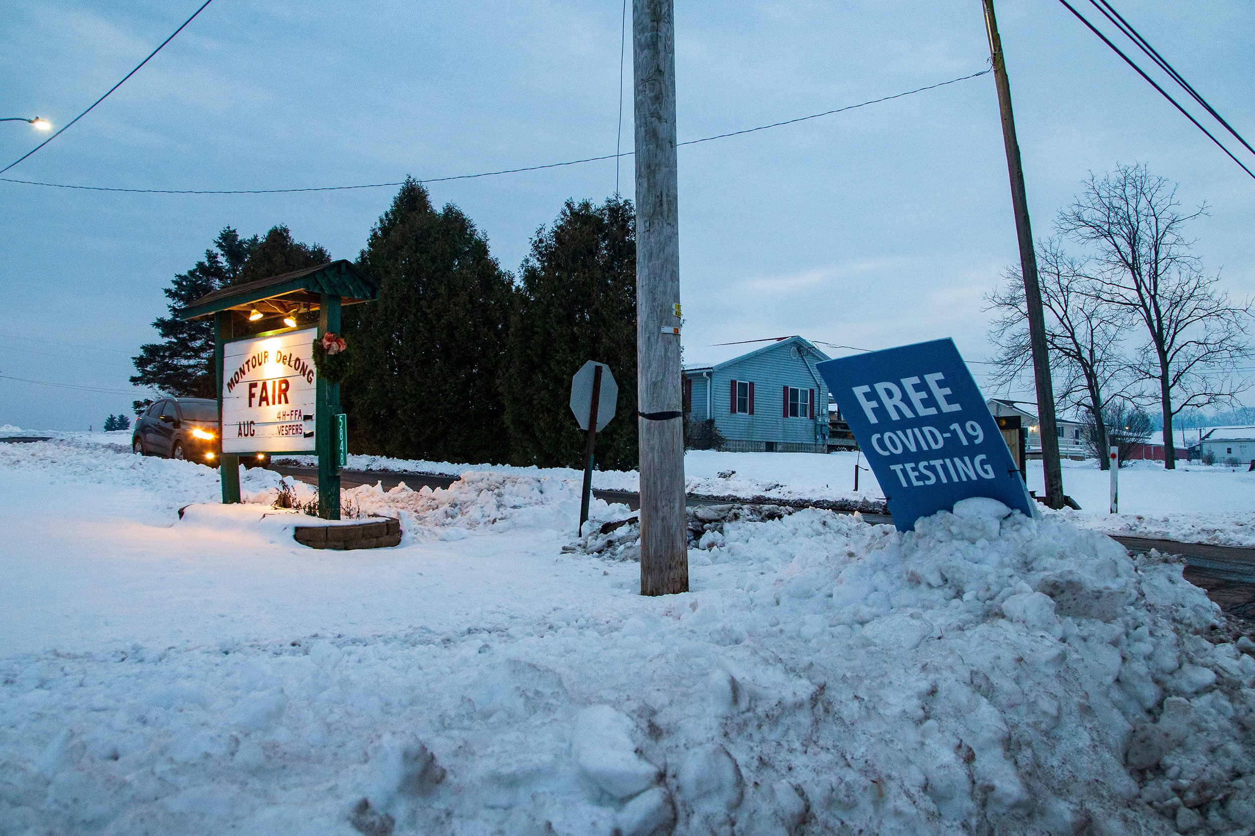 A sign for free coronavirus testing is propped in the snow at the Montour-Delong Community Fairgrounds near Danville, Pennsylvania, on December 21.