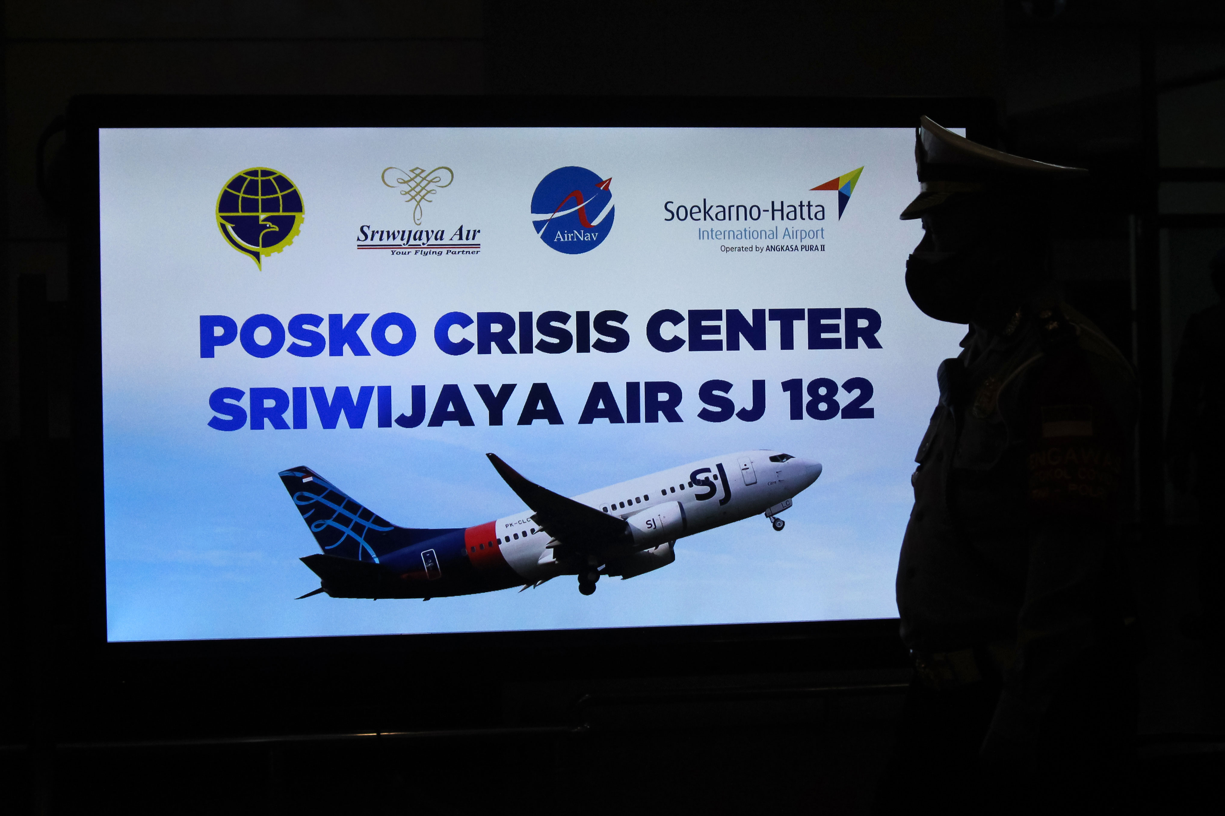 A security personnel stands in front of a crisis center sign at Soekarno-Hatta International Airport in Tangerang, Indonesia, on January 9.
