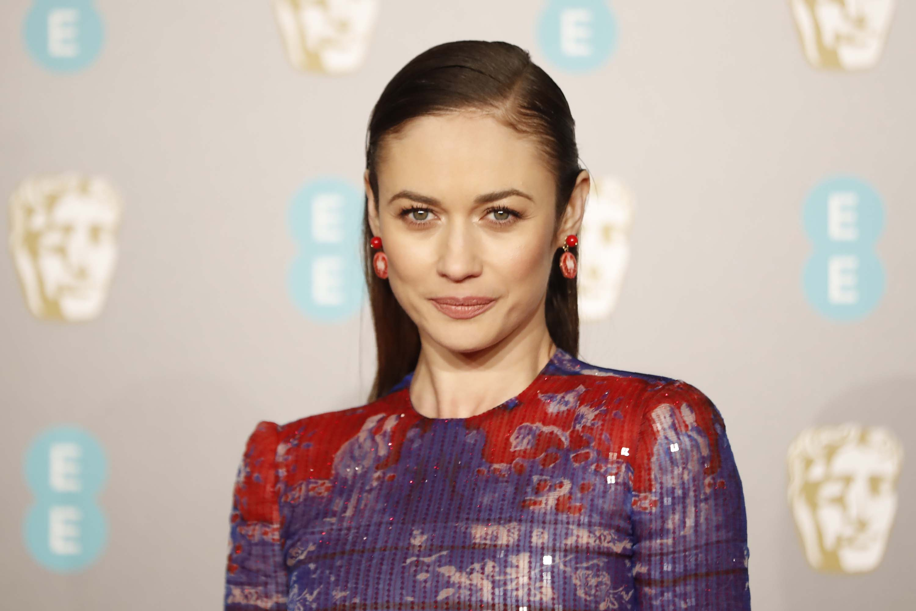 French actress and model Olga Kurylenko poses on the red carpet upon arrival at the BAFTA British Academy Film Awards in London, in February 2019.