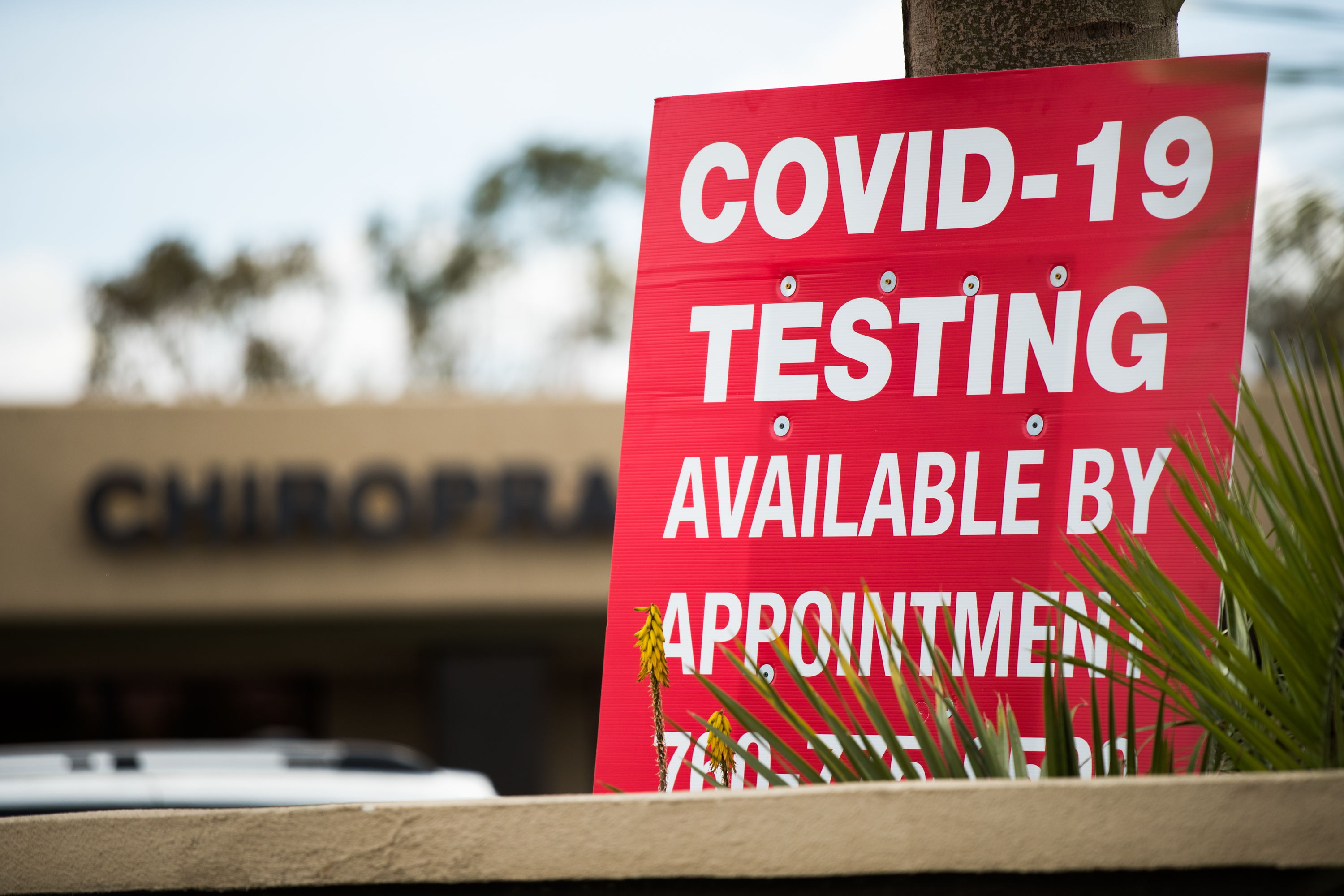 A sign about Covid-19 testing is seen in Indio, California, on April 9.