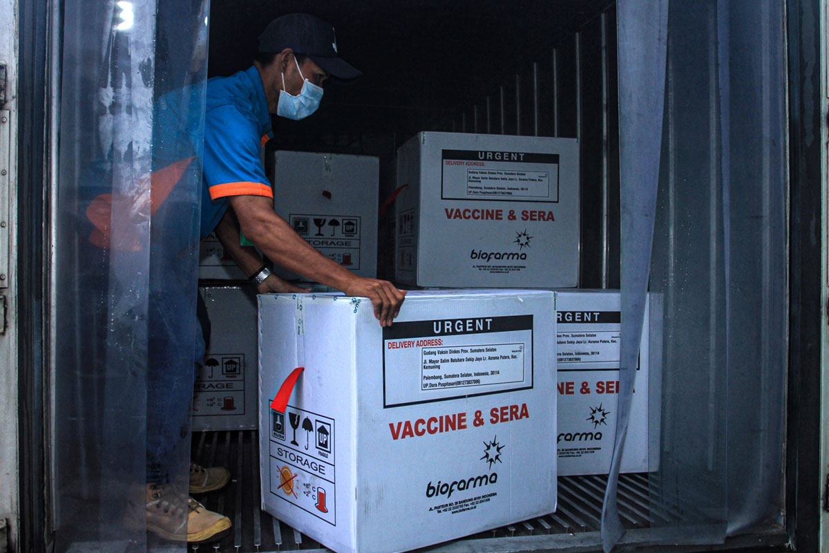 A health officer unloads boxes of Sinovac's Covid-19 vaccine in Palembang, Indonesia on January 4.