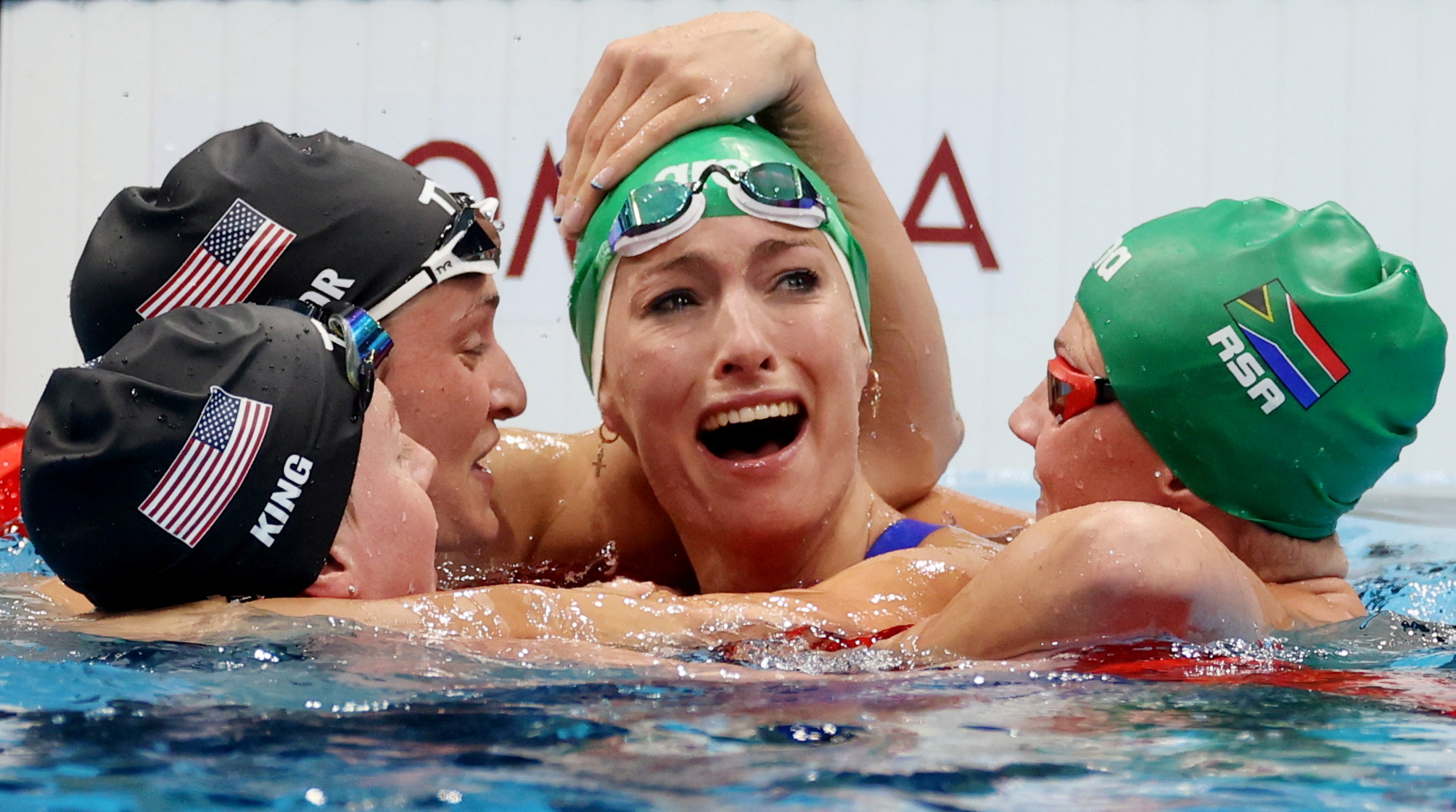 South African swimmer Tatjana Schoenmaker is congratulated by some of her fellow competitors — from left, American Lilly King, American Annie Lazor and South African Kaylene Corbett — afterwinning gold in the 200 meters breaststrokeon July 30.