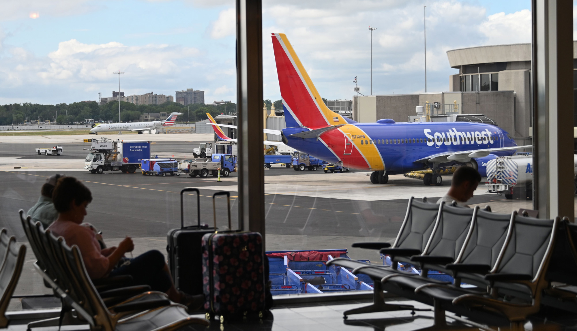 Passengers wait at the Southwest Airlines counter at Ronald Reagan Washington National Airport on July 10 in Arlington, Virginia.