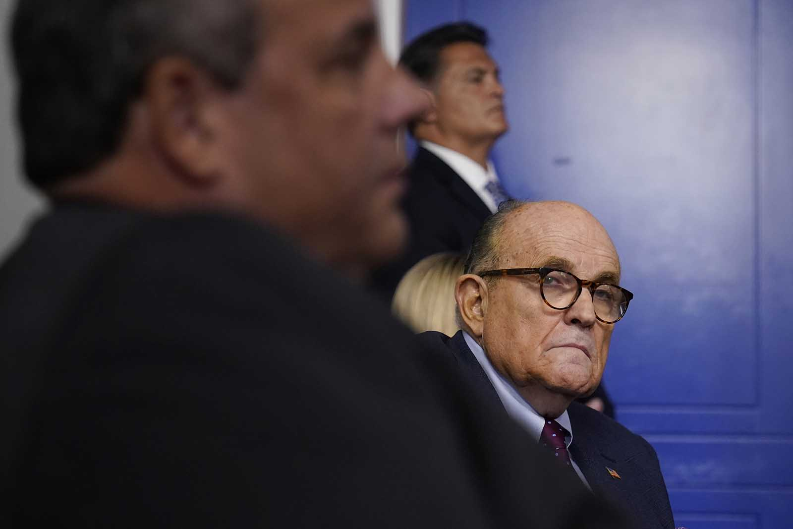 Former New Jersey Gov. Chris Christie, left, and former New York Mayor Rudy Giuliani attend a news conference with President Donald Trump at the White House, on Sunday, September 27 in Washington.