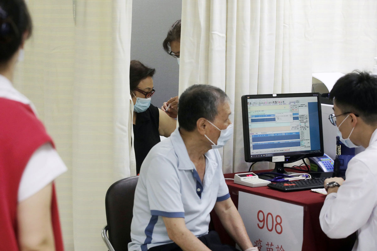 A person is administered with a dose of the Covid-19 vaccine at a vaccination center in New Taipei City, Taiwan, on May 13.
