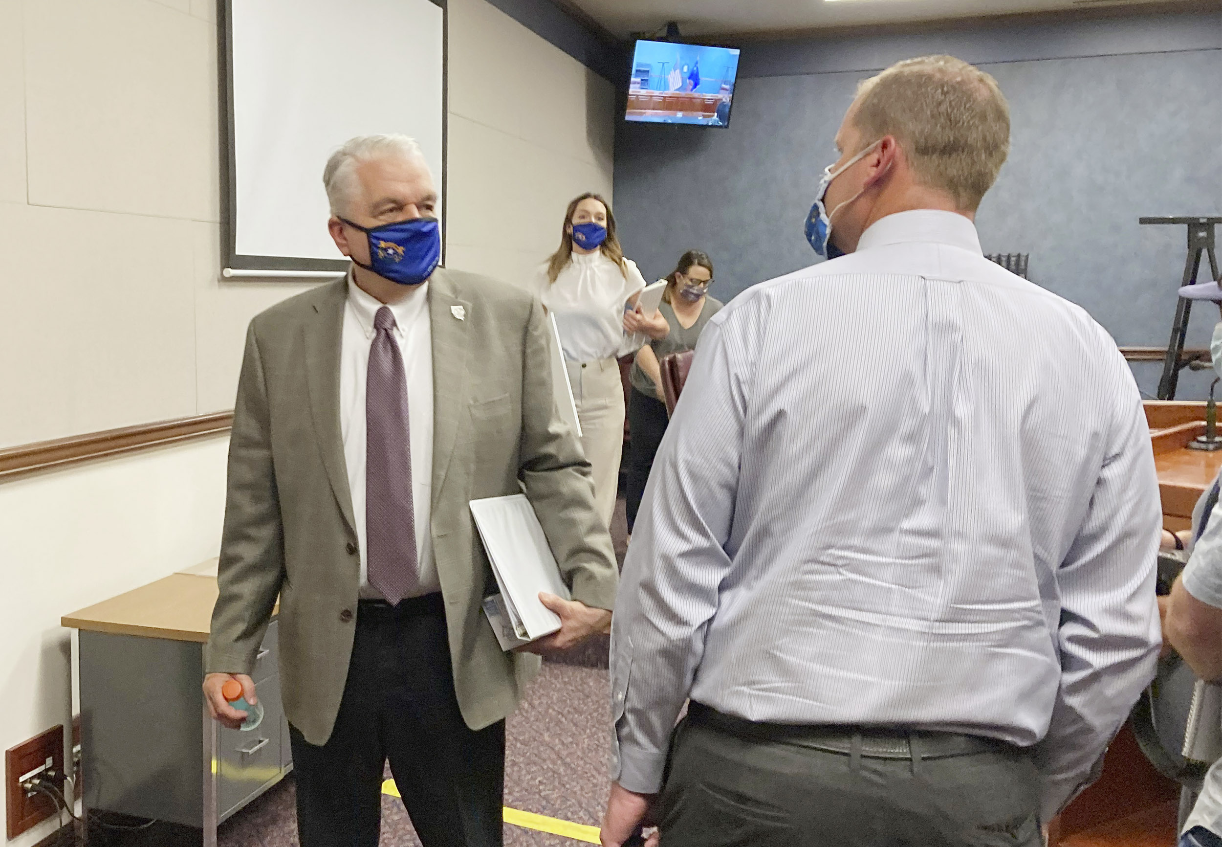 Gov. Steve Sisolak exits a news conference at the Nevada State Legislature in Carson City, Nevada on Wednesday, June 24.