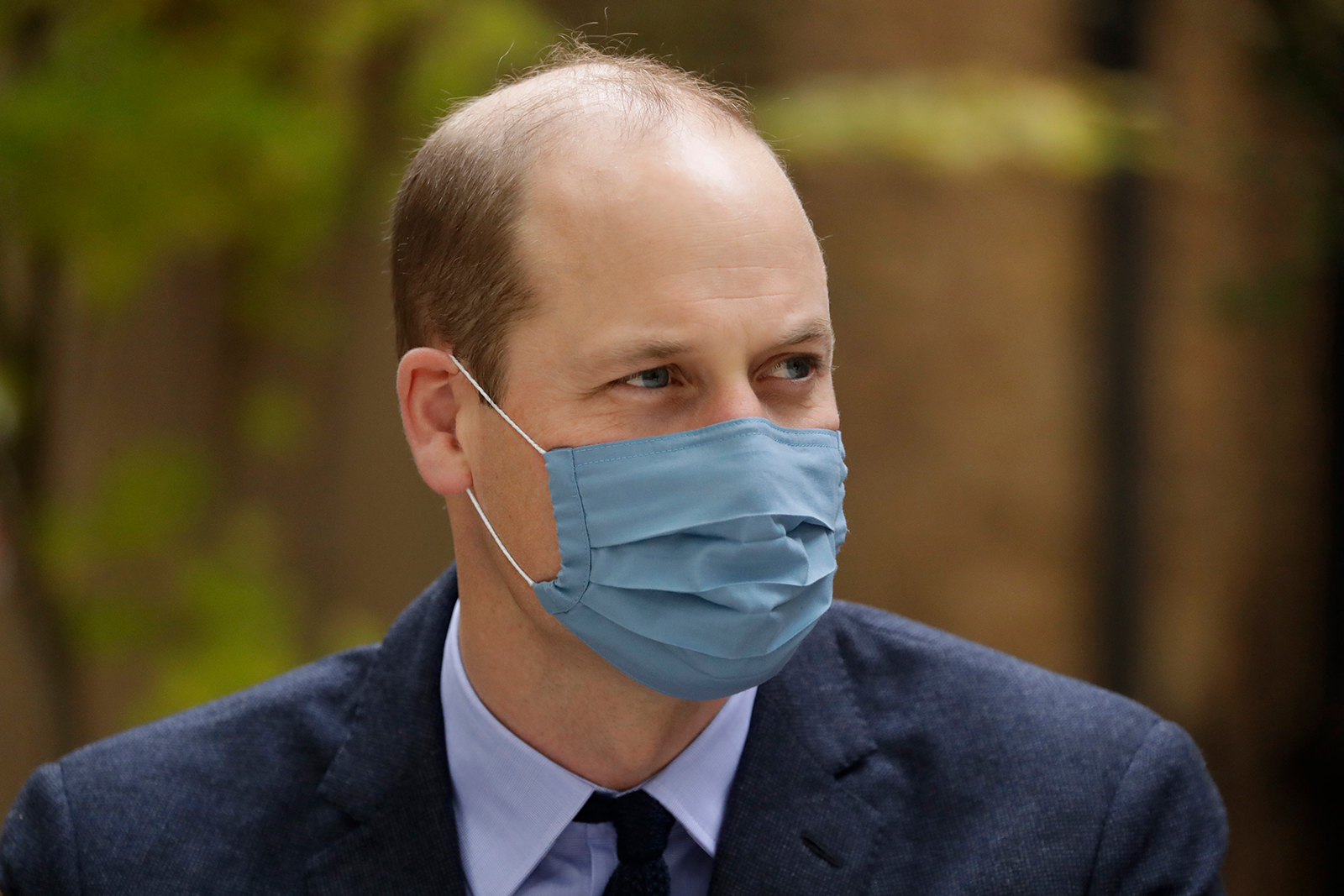 Wearing a face covering to curb the spread of coronavirus, Prince William, is seen here on a visit to St. Bartholomew's Hospital in London, England, on October 20.