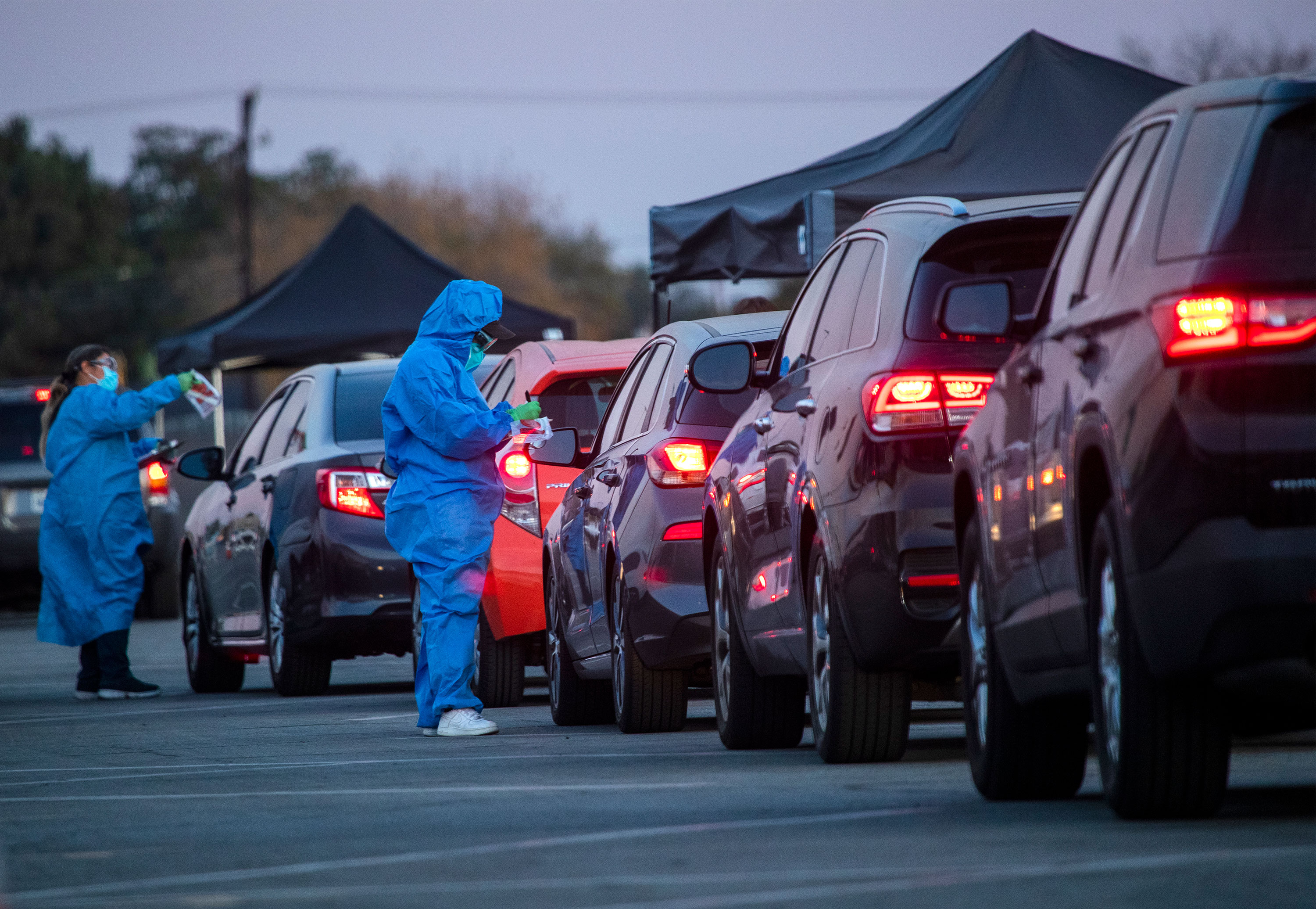 Health care workers hand out Covid-19 tests to motorists on December 9 in Long Beach, California.