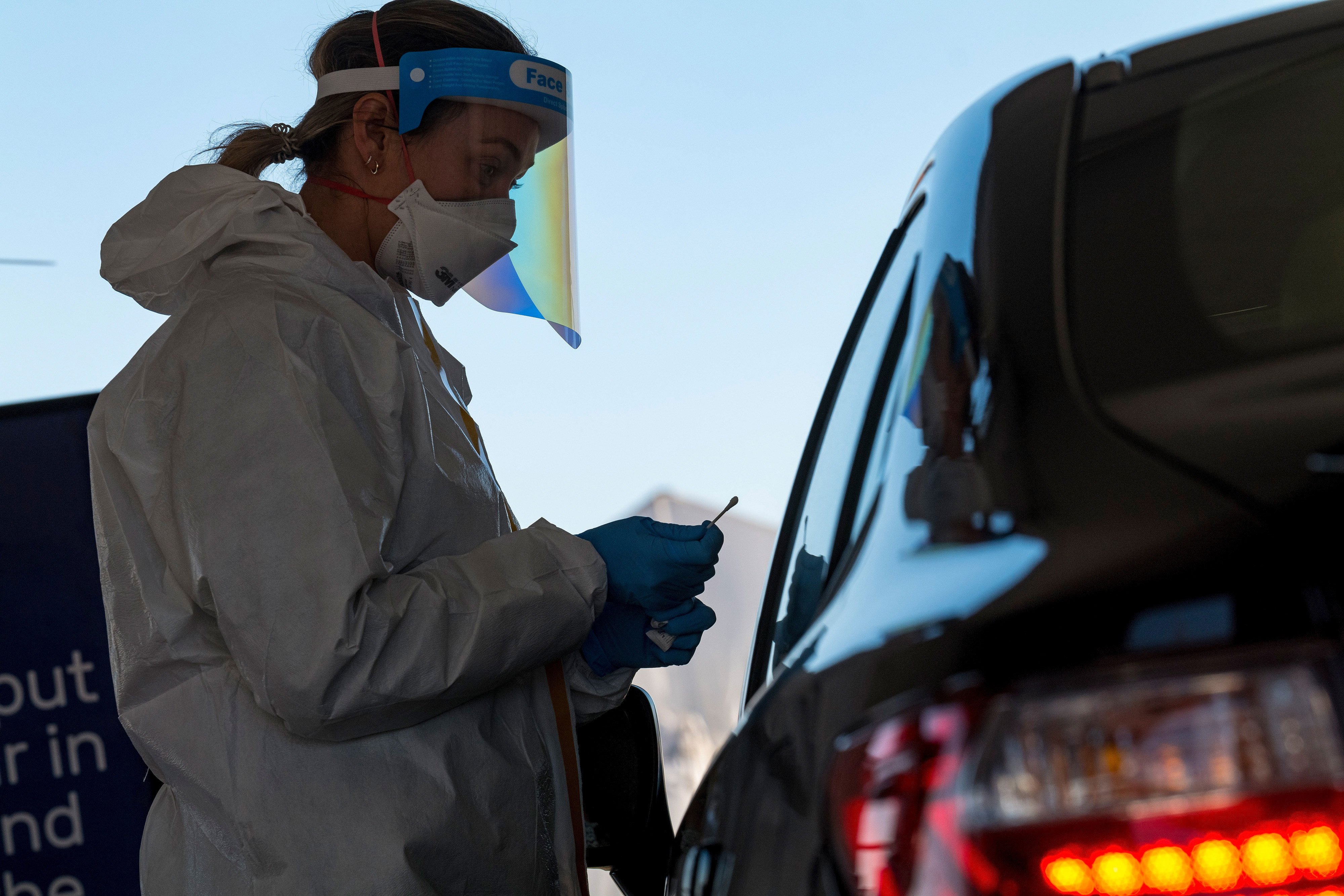 A health care worker in San Francisco administers a nasal swab test at a Covid-19 testing site on December 1.