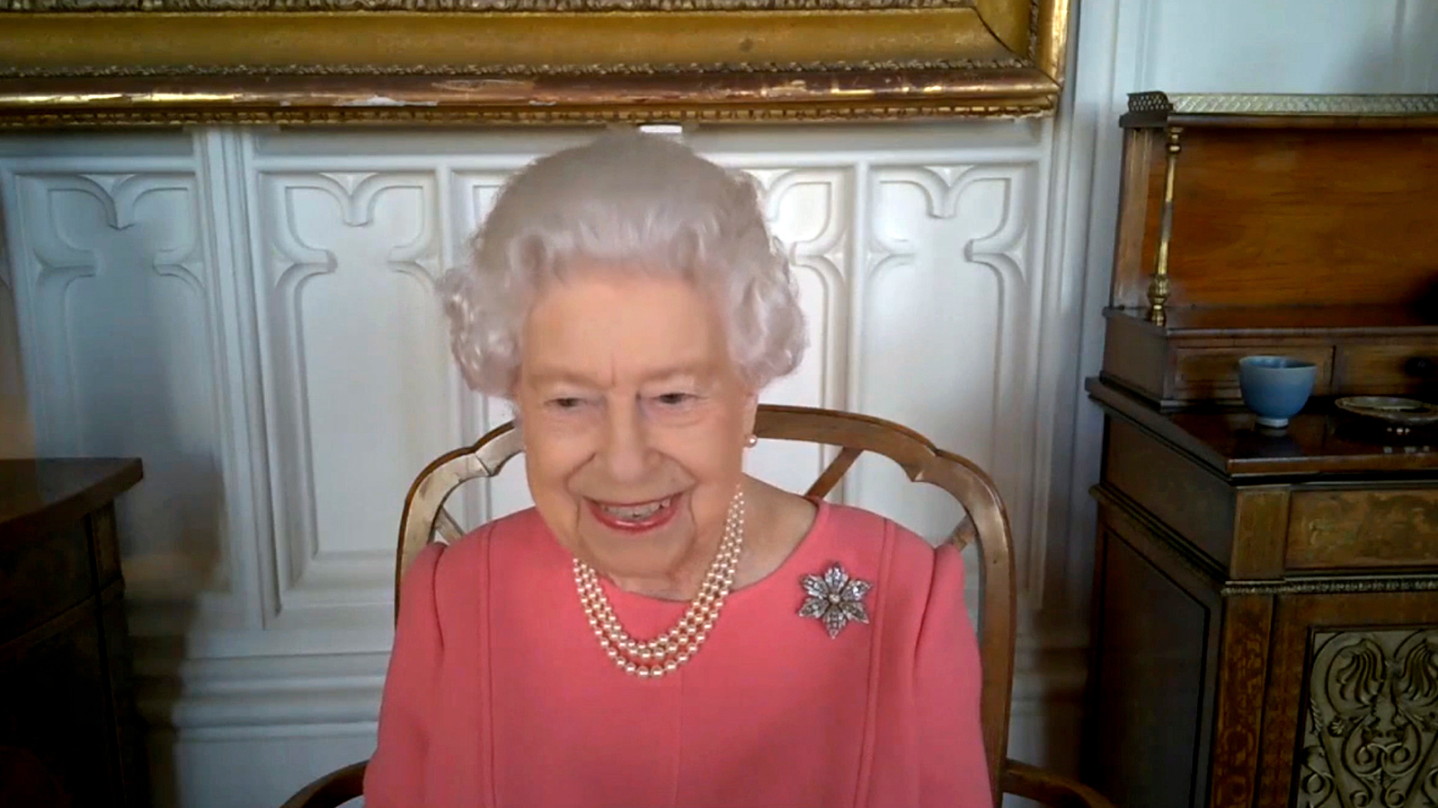 In this undated handout photo provided by Buckingham Palace on February 25, Britain's Queen Elizabeth smiles on a video call with the four health officials leading the deployment of the COVID-19 vaccination in England, Scotland, Wales and Northern Ireland.