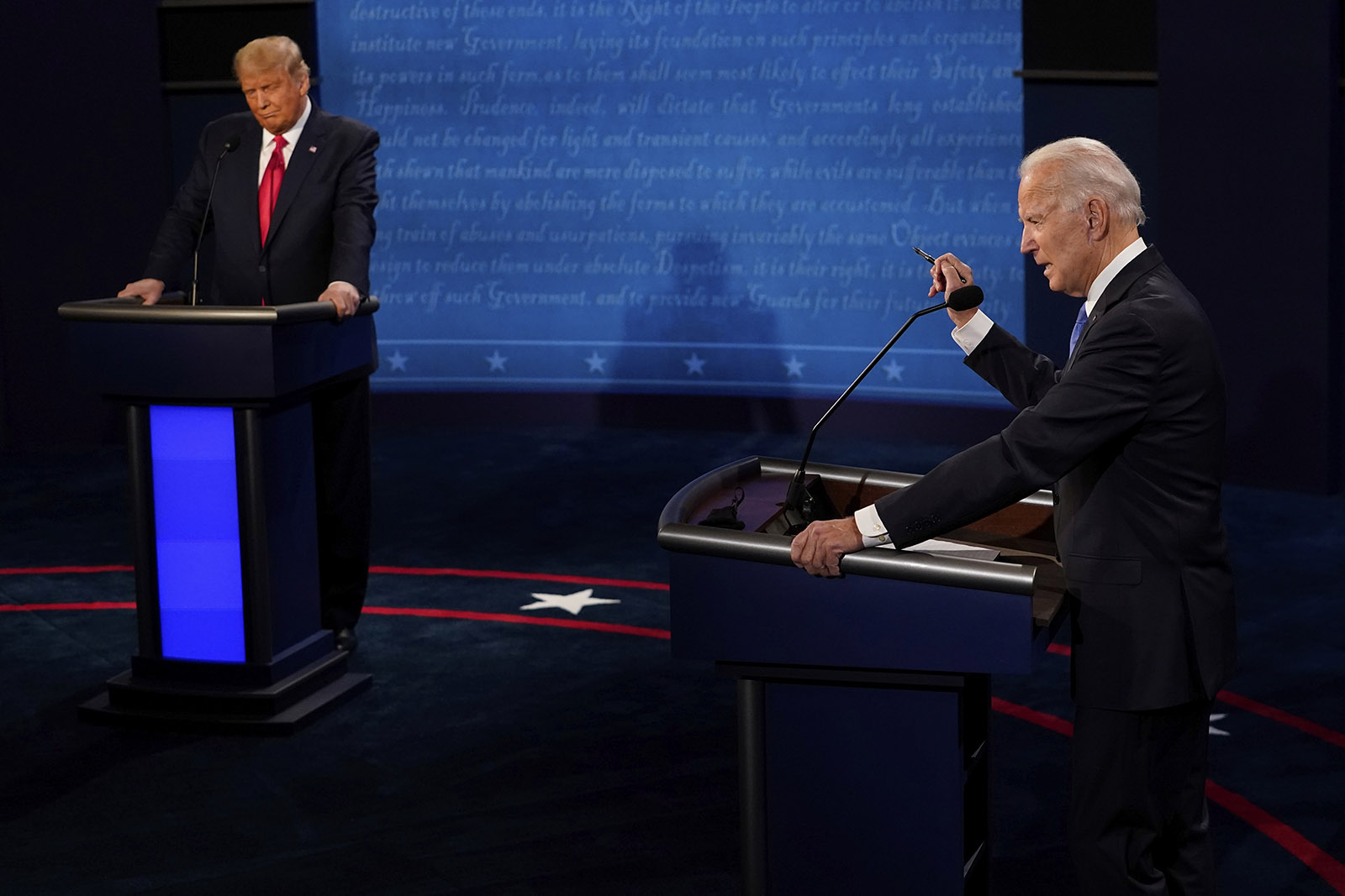 Democratic presidential candidate Joe Biden answers a question and President Donald Trump listens during the second and final presidential debate Thursday in Nashville.