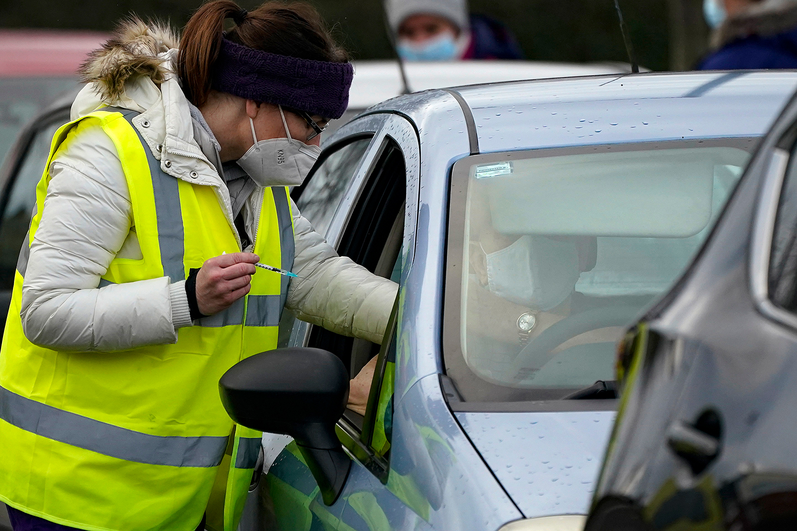 A man sits in his car as he is administered a coronavirus vaccine at a drive-thru Covid-19 vaccination centre at Hyde Leisure Centre on January 8, 2021 in Hyde, England.