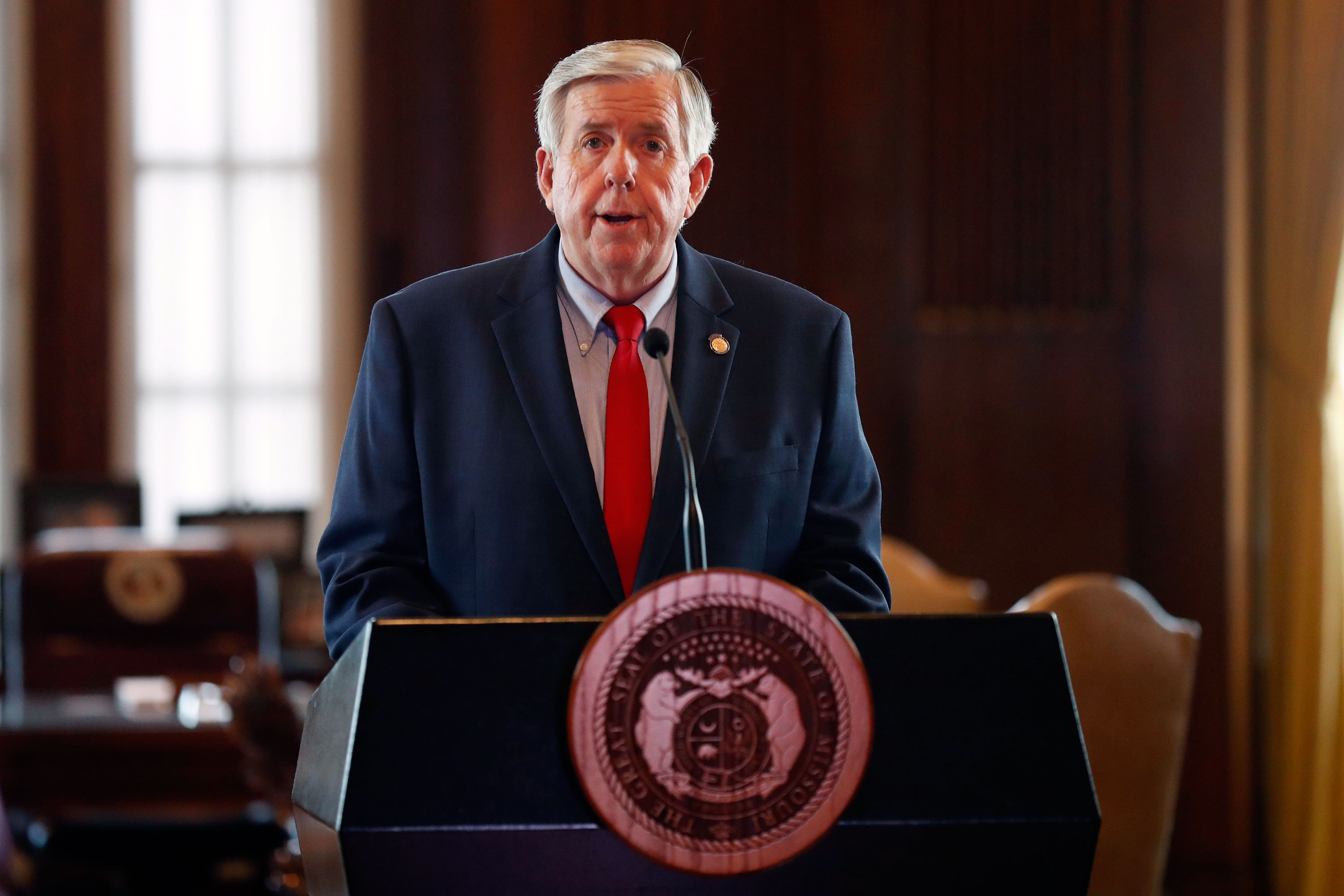 Gov. Mike Parson conducts his daily coronavirus briefing on April 27, in Jefferson City, Missouri.