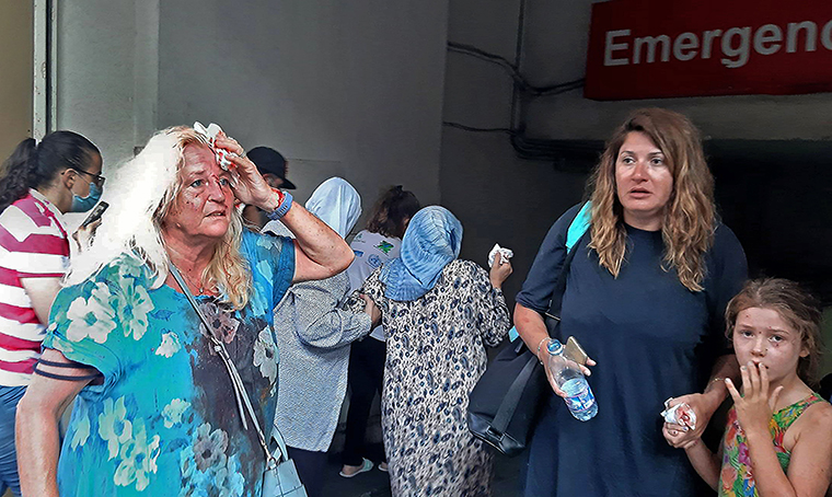 Valarie Fakhoury, a British grandmother with her Lebanese daughter and granddaughter, stand outside the emergency ward of a hospital in central Beirut.
