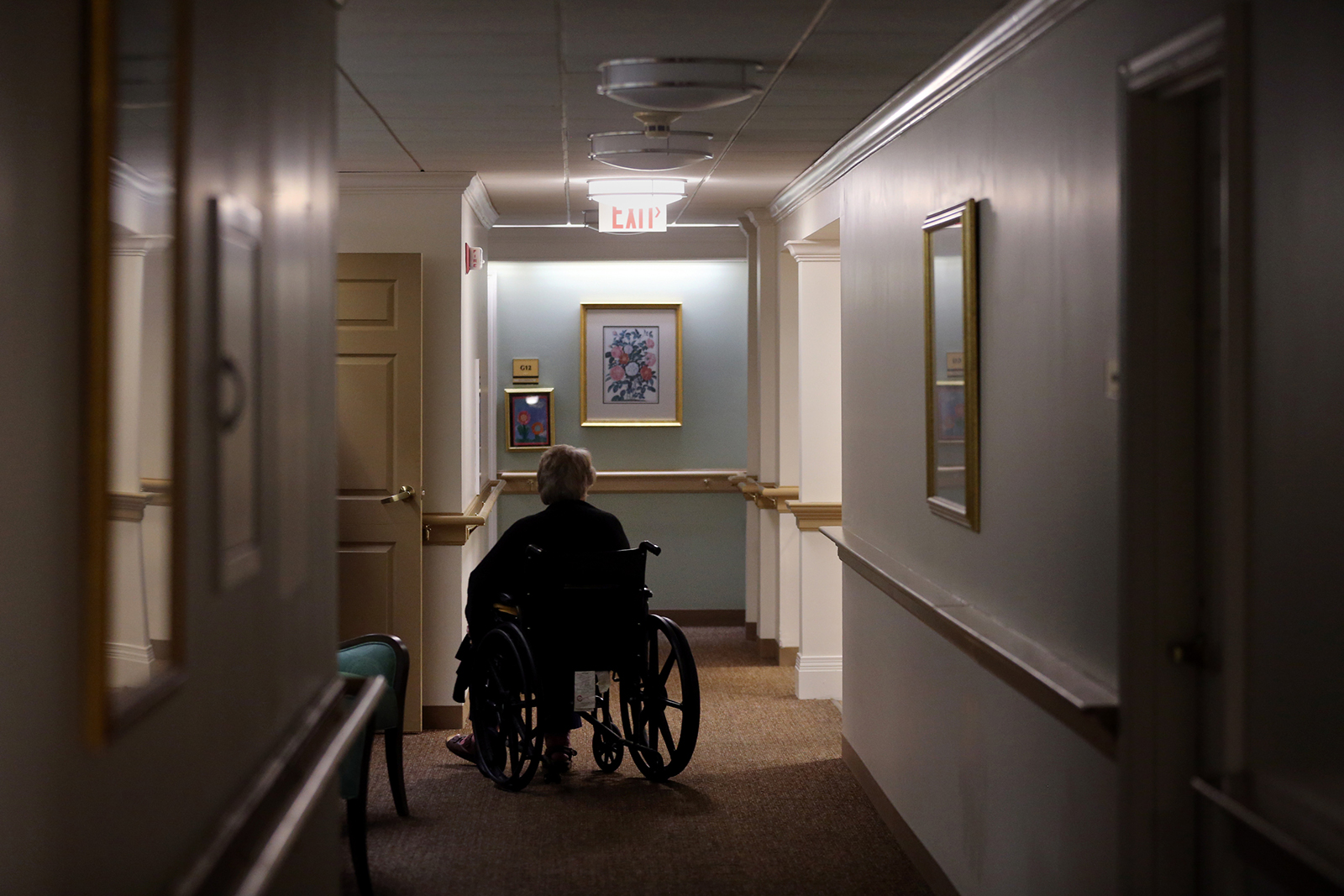 A resident sits in a wheelchair at an assisted living facility in Boston on September 2, 2020.