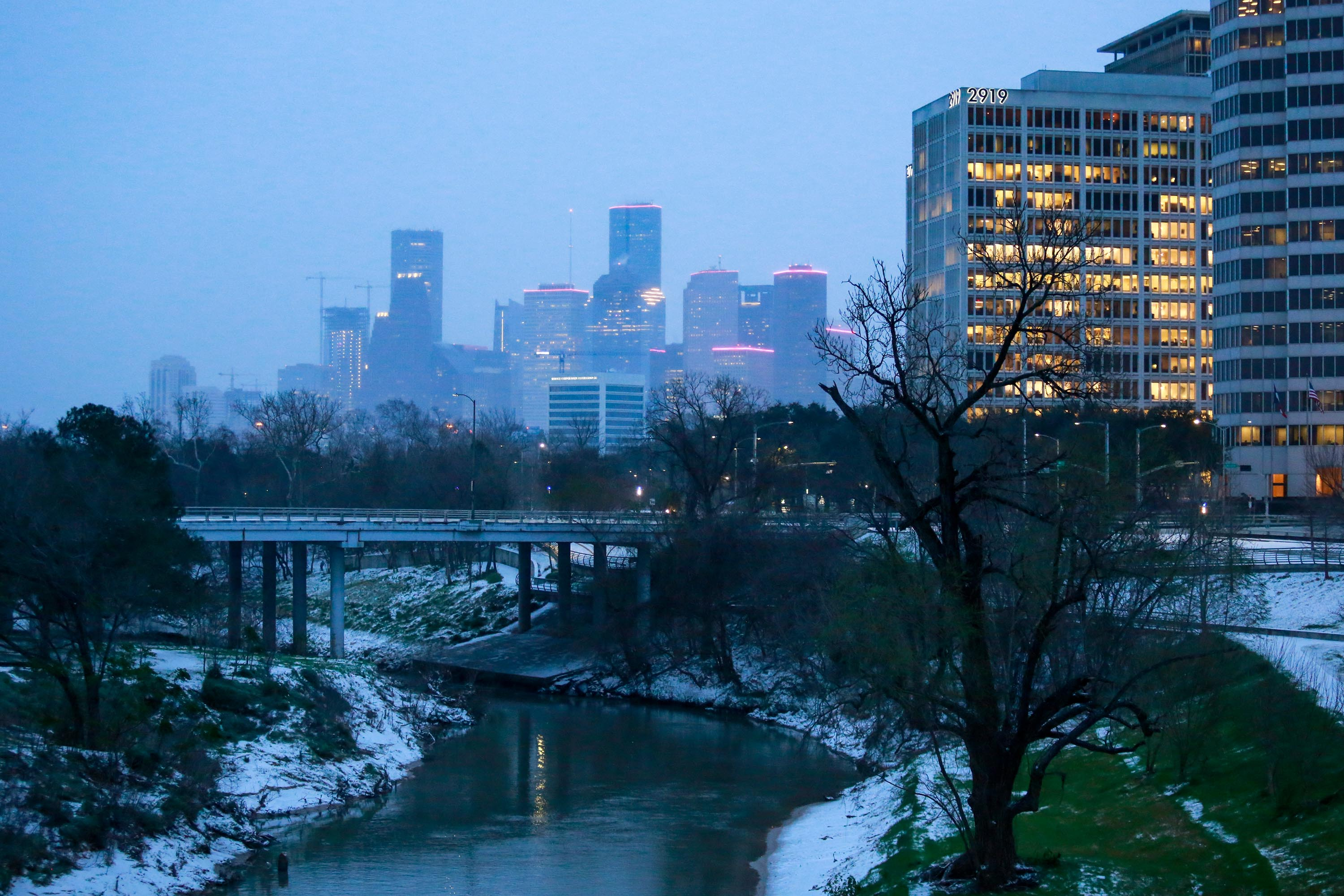 The Houston skyline seen from Buffalo Bayou Park early on the morning of Monday, February 15, after the snow storm.