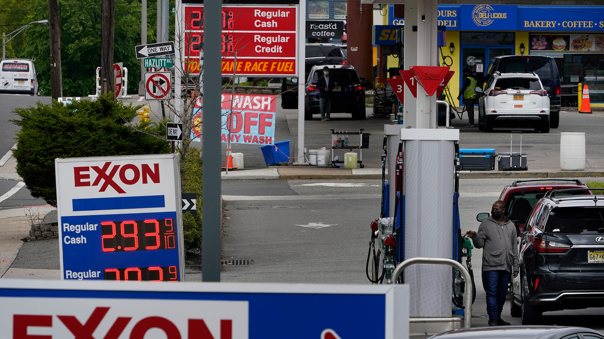 Gas stations display the price of gasoline in Leonia, New Jersey, on Monday, May 10.