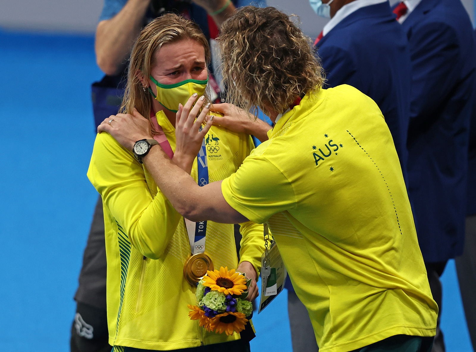 Ariarne Titmus of Team Australia reacts with her coach Dean Boxall after winning the gold medal in the 200m freestyle final on July 28.