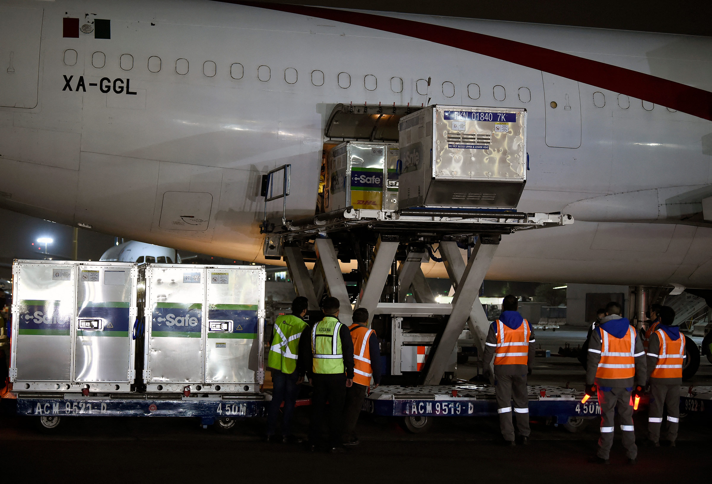 Employees unload shipping containers of the AstraZeneca Covid-19 vaccine at Benito Juarez International Airport in Mexico City, on March 28.