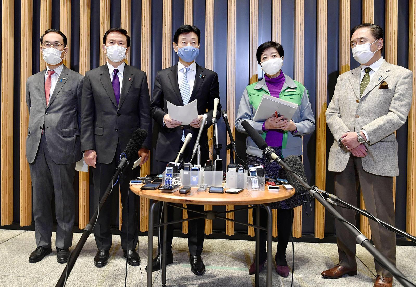 From left to right, Saitama Gov. Motohiro Ono, Chiba Gov. Kensaku Morita, Yasutoshi Nishimura, Japan's minister in charge of coronavirus response, Tokyo Gov. and Kanagawa Gov. Yuji Kuroiwa meet the press after their meeting in Tokyo, on January 2.