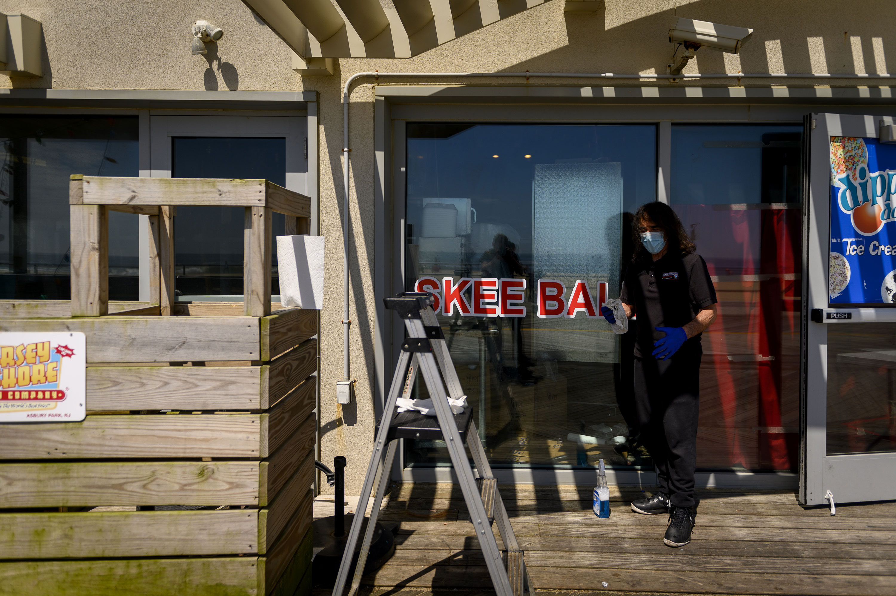 An employee cleans the windows at the Silverball Museum Arcade in Asbury Park, New Jersey, on May 22.