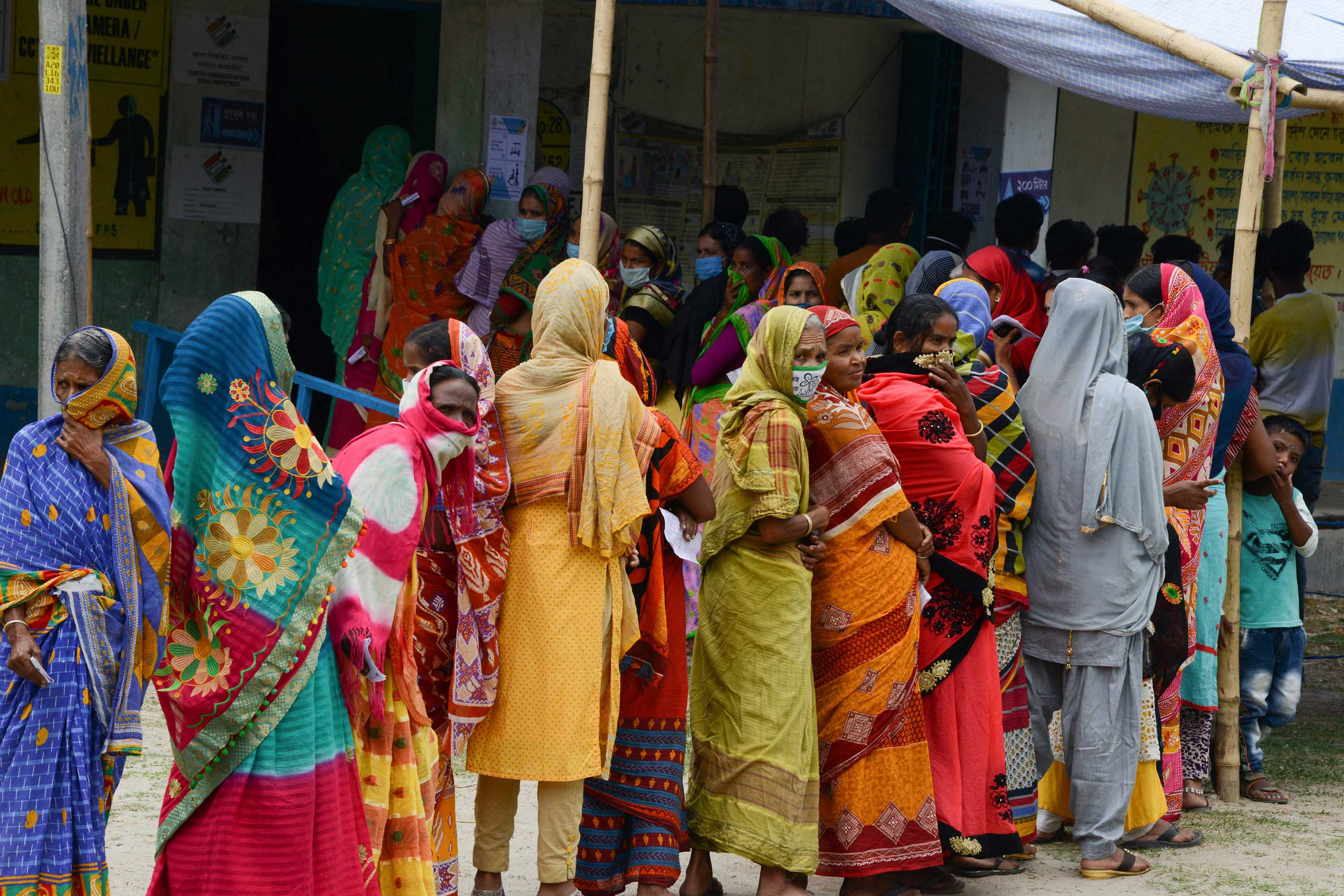 People queue to caste their votes during the 6th phase of the legislative assembly election at Boknabandha village, in India's Dinajpur district, on April 22.
