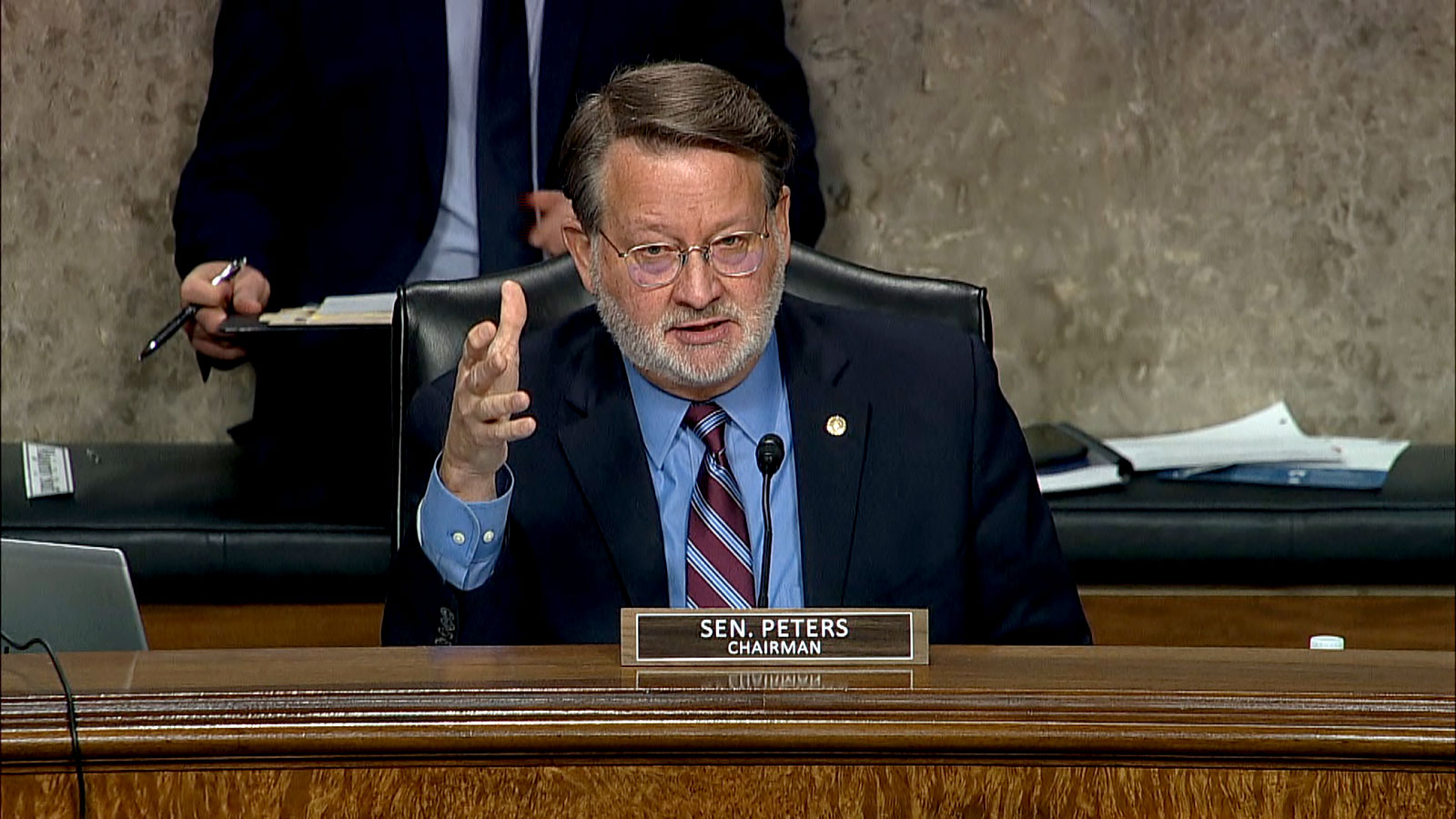Sen. Gary Peters asks the witnesses a question during the hearing.