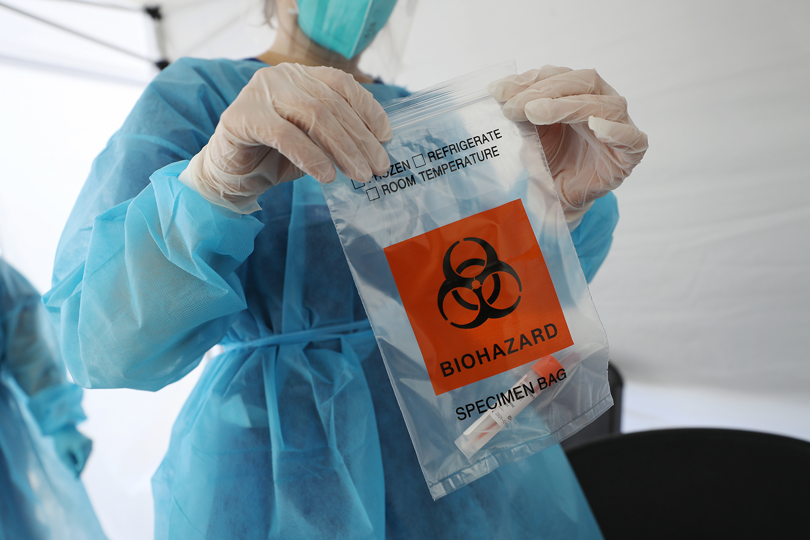 A nurse seals a specimen bag containing a Covid-19 test swab at a mobile clinic set up in South Los Angeles on July 15.