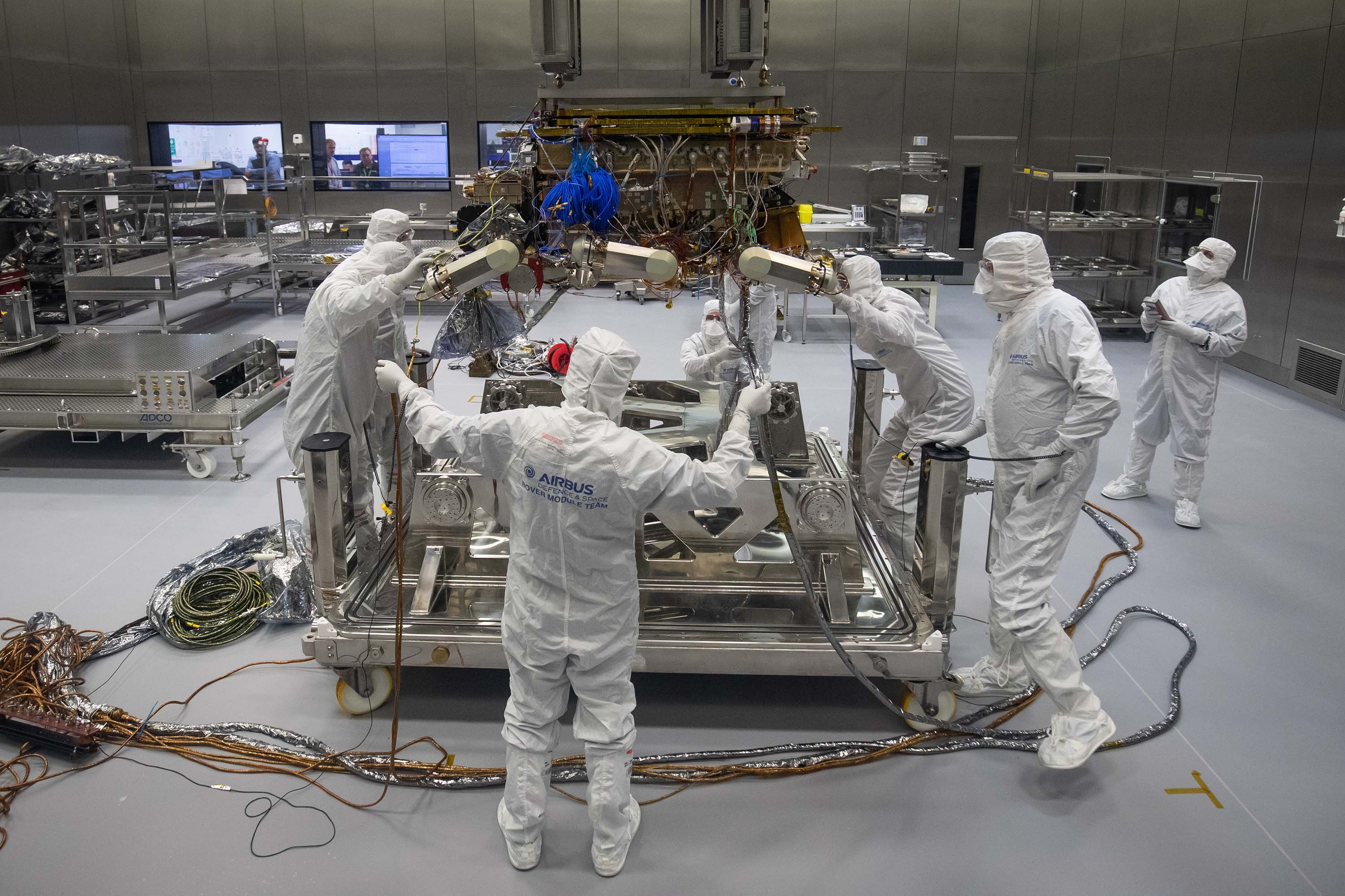 Workers prepare the European Space Agency's ExoMars rover at an Airbus facility in Stevenage, England, in August 2019.
