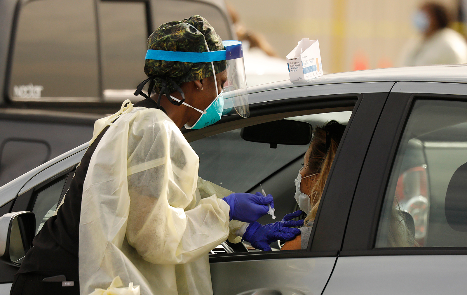 Staff and volunteers distribute the Covid-19 vaccine to people as they remain in their vehicles at The Forum in Inglewood, California, on, January 19.