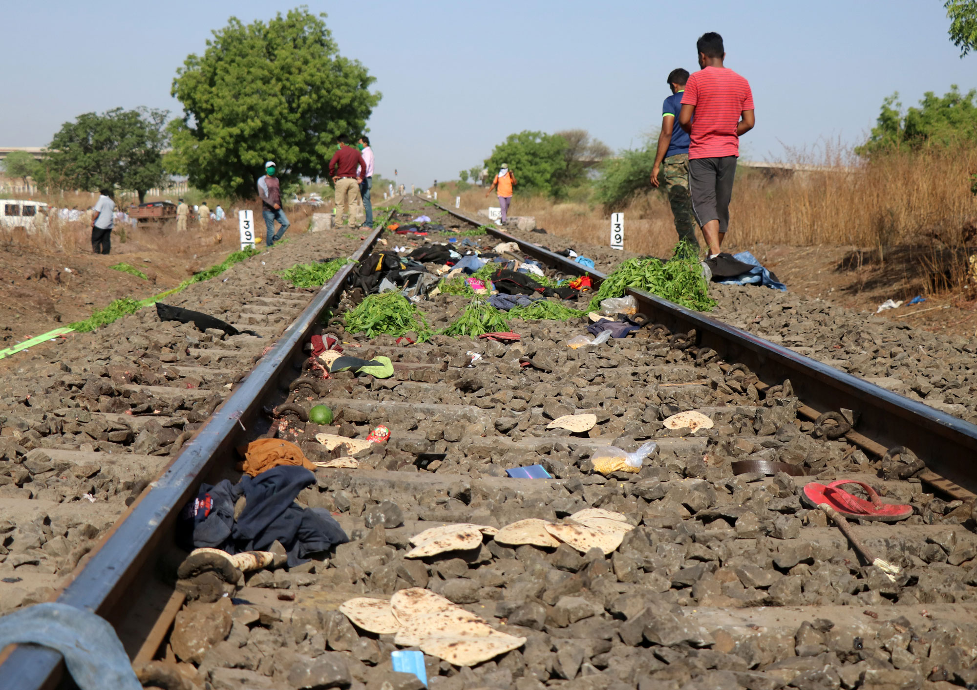 The belongings of victims are scattered on the railway track after a train ran over migrant workers sleeping in the Aurangabad district of Maharashtra, India, on May 8.