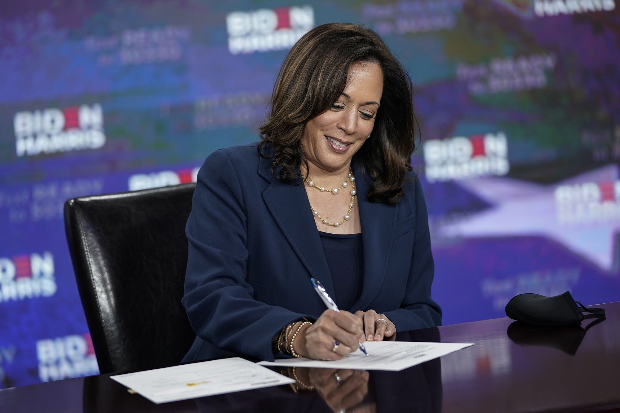 Presumptive Democratic vice presidential nominee, Sen. Kamala Harris signs required documents for receiving the Democratic nomination for Vice President of the United States at the Hotel DuPont on August 14 in Wilmington, Delaware.