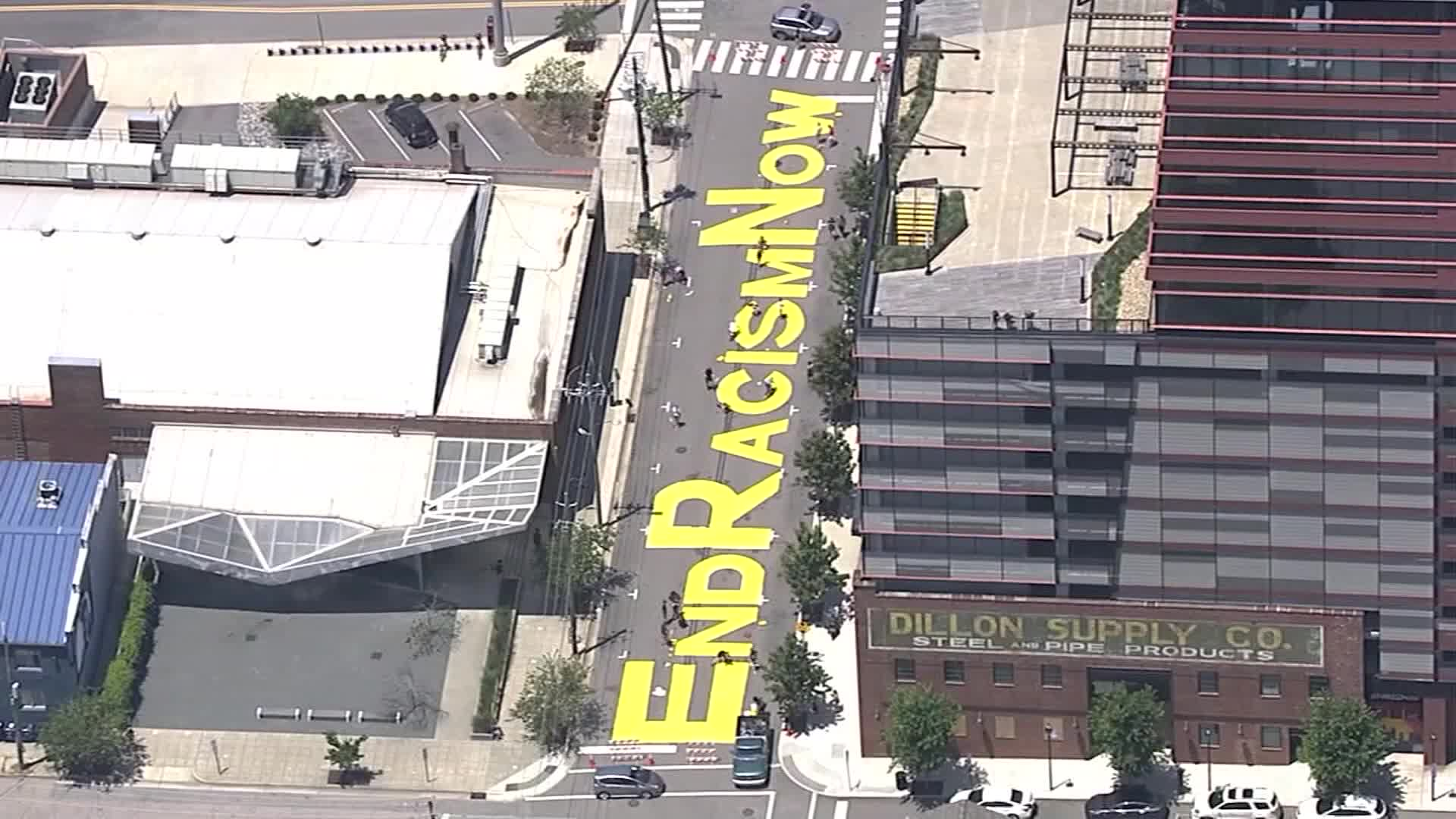 "Protesters painted the words ""End Racism Now"" in bold yellow on the street in front of the Contemporary Art Museum in Raleigh, NC."