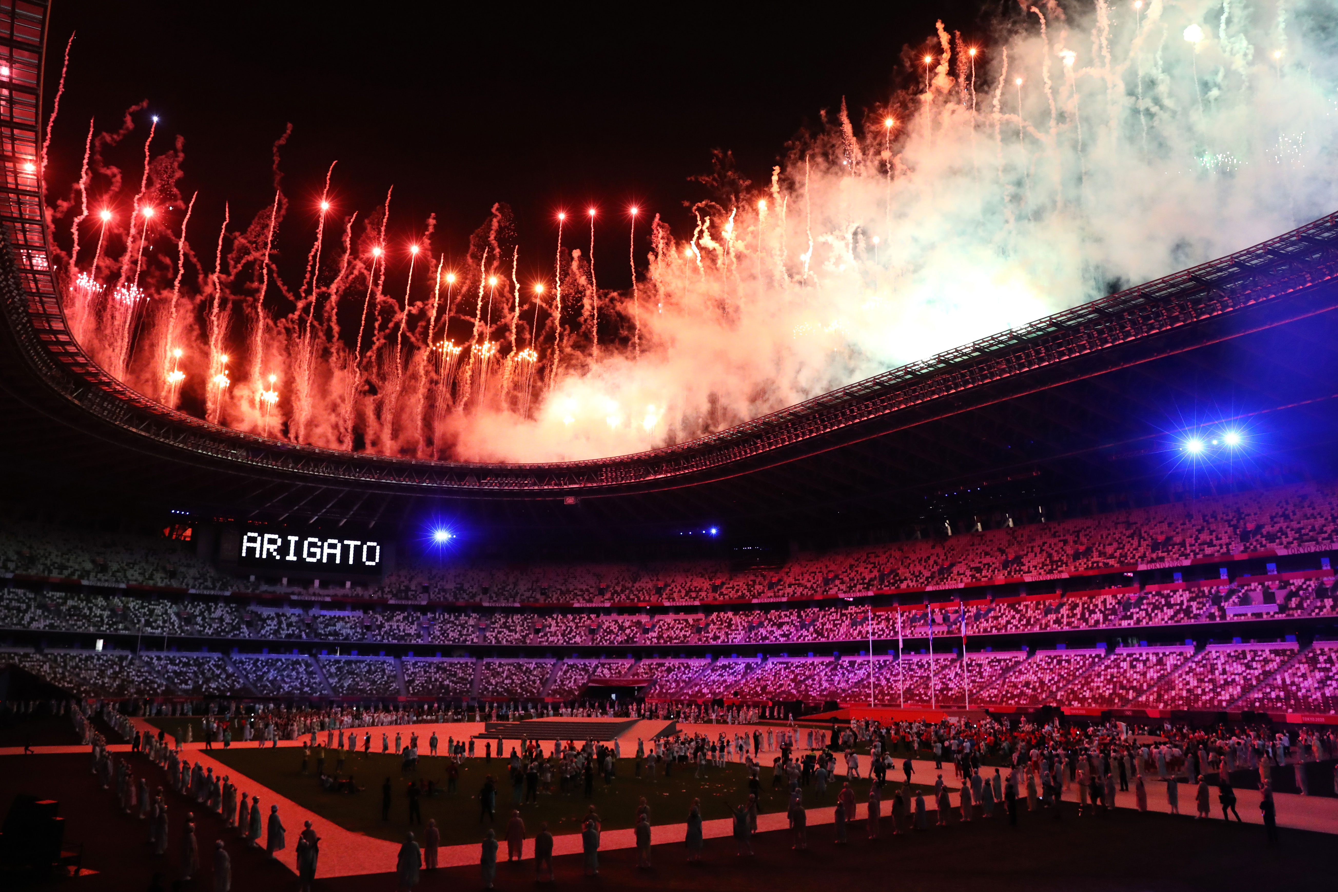 Fireworks explode over Tokyo's National Stadium at the end of the Olympics' closing ceremony on August 8. The word