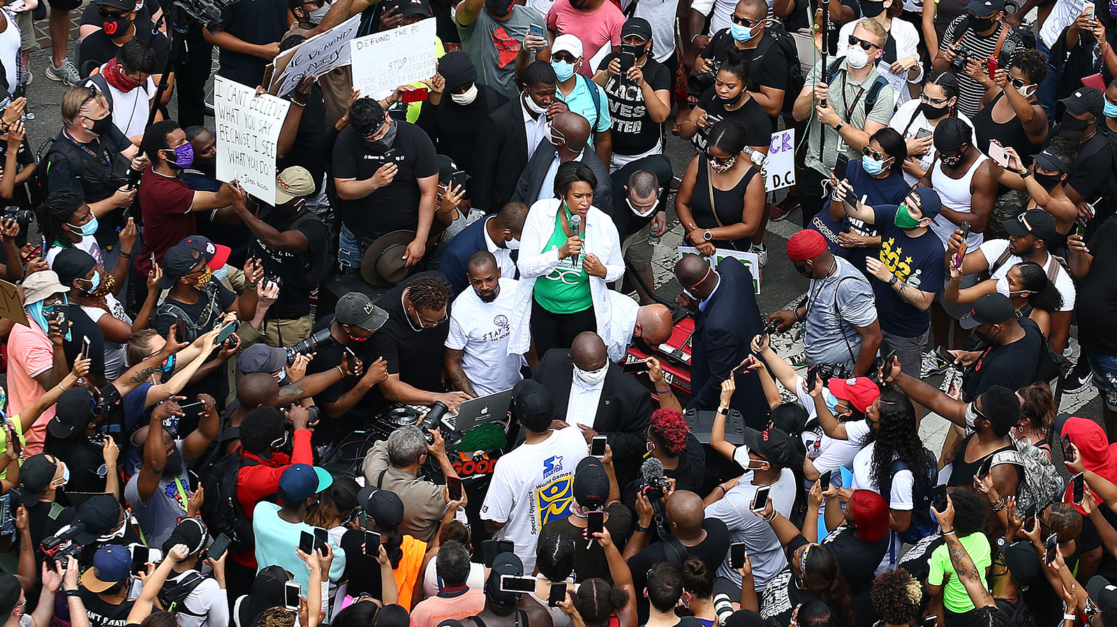 District of Columbia Mayor Muriel Bowser (C) speaks to demonstrators gathered on the newly named Black Lives Plaza during a peaceful protest against police brutality and racism in Washington, DC on June 6.