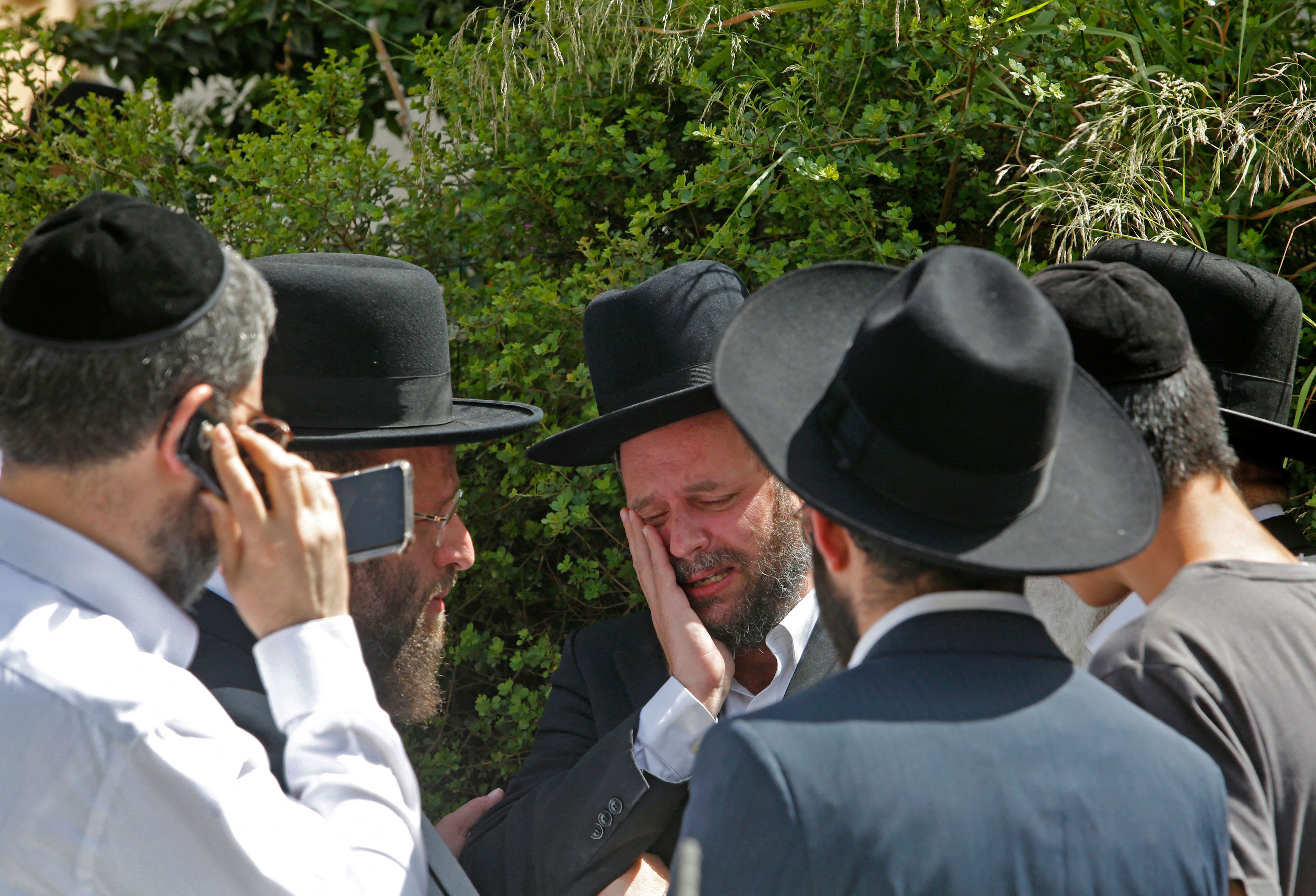 A person cries at a cemetery in Bnei Brak, Israel, on April 30 at the funeral for one of the victims of the Lag B'Omer stampede.