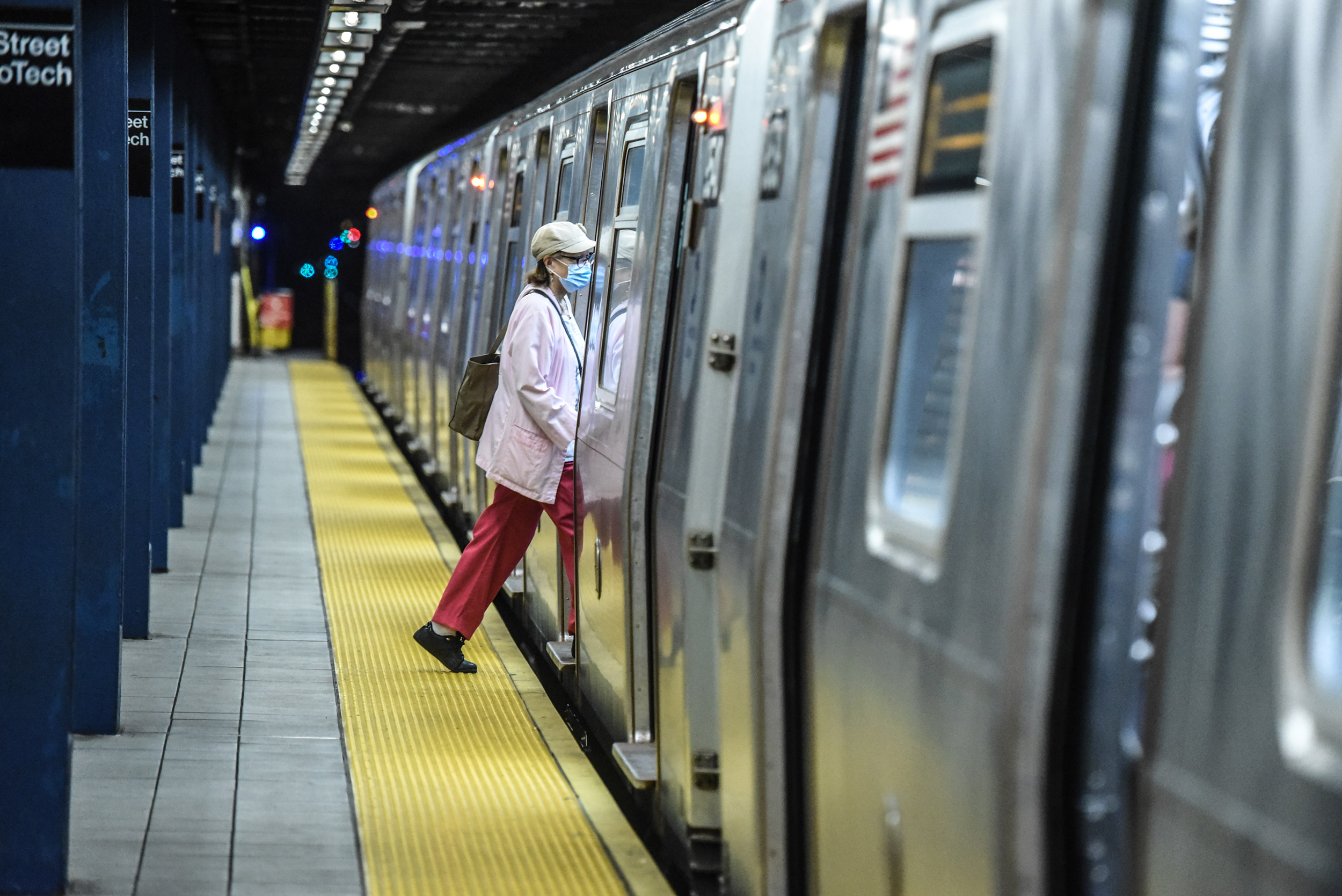 A person commutes on the subway in the Brooklyn borough on June 22 in New York City.
