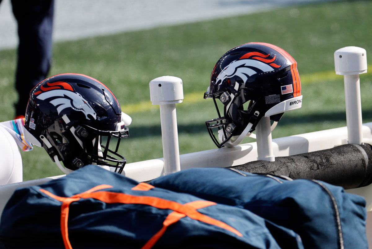 Denver Broncos helmets hang on the bench before a game with the New England Patriots on October 18 at Gillette Stadium in Foxborough, Massachusetts.
