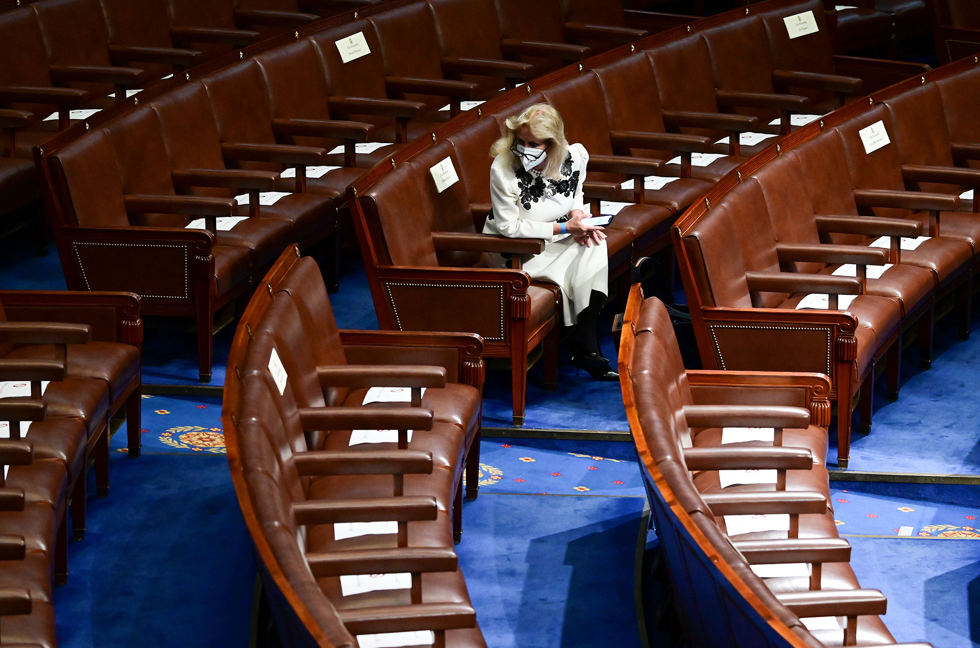 Rep. Debbie Dingell waits in her seat ahead of President Joe Biden speaking to a joint session of Congress, on Wednesday, April 28, in Washington.