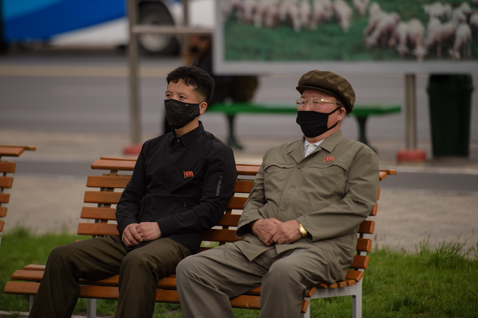People watch a screen showing a broadcast in Pyongyang on May 2.