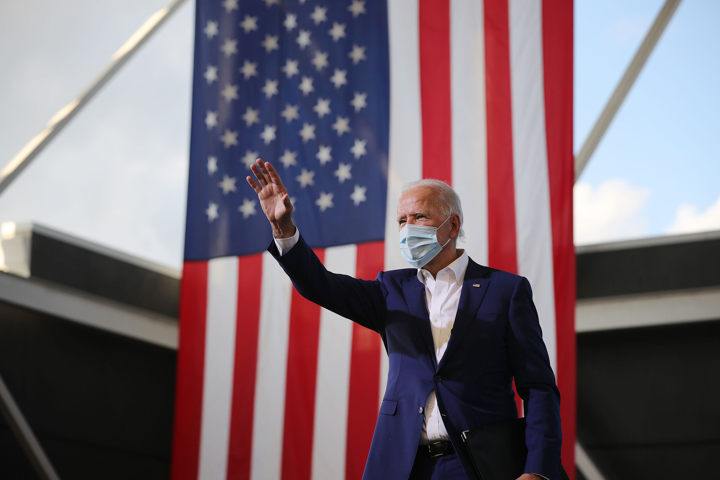 Democratic presidential nominee Joe Biden waves to supporters during a drive-in voter mobilization event at Miramar Regional Park on October 13 in Miramar, Florida.
