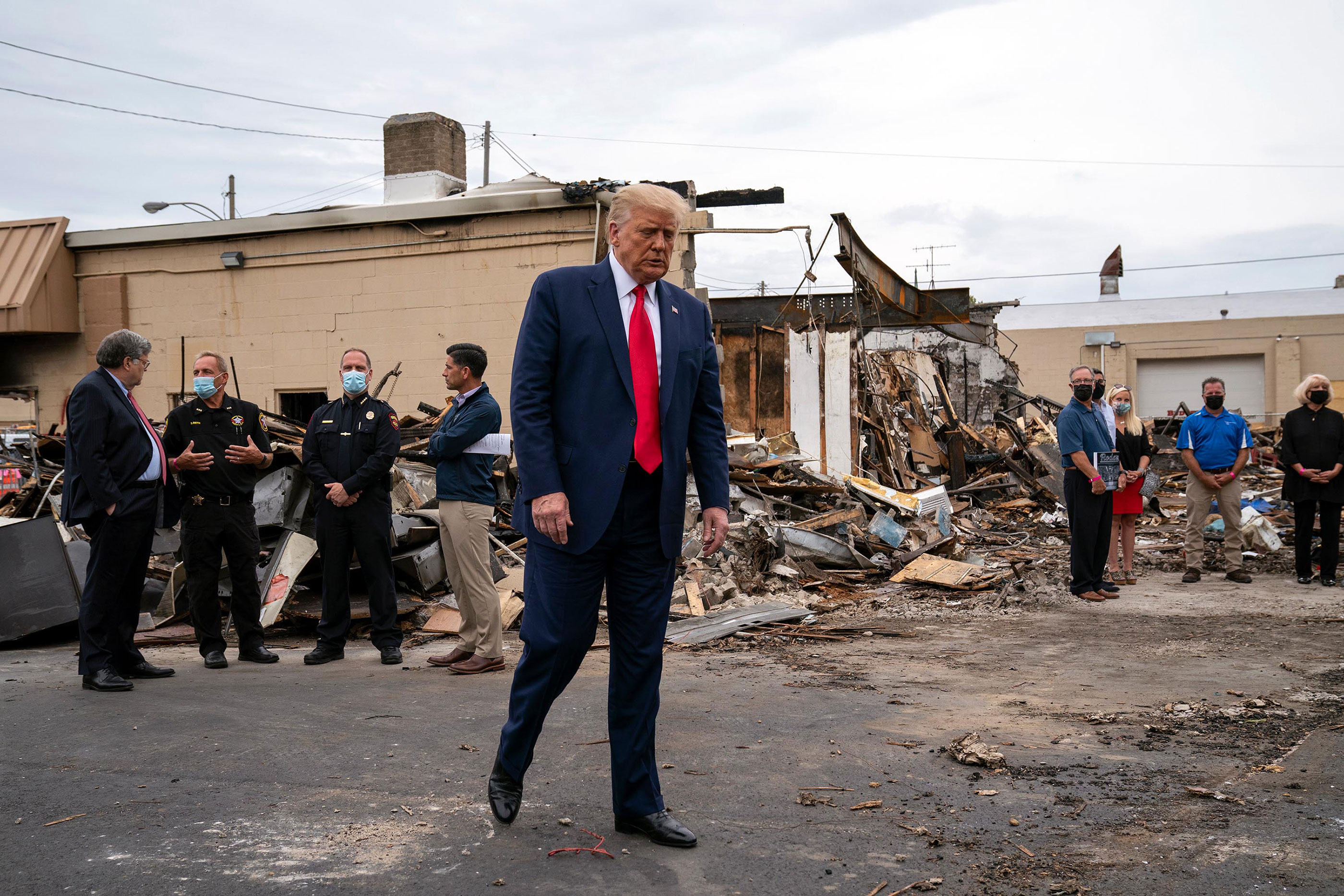 President Donald Trump tours an area on September 1 that was damaged during demonstrations in Kenosha, Wisconsin.