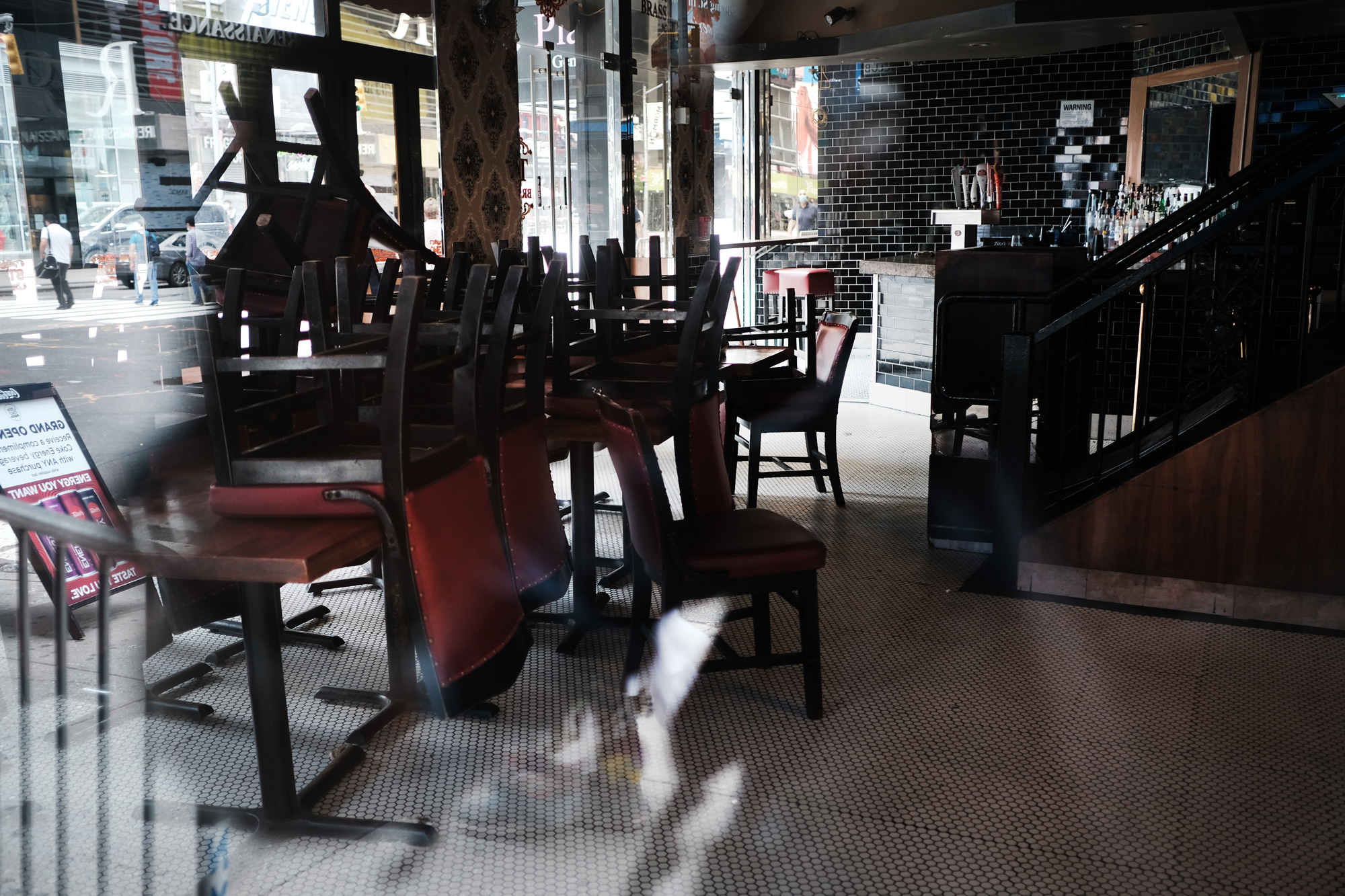 Chairs are piled-up inside of a closed restaurant in Manhattan on August 31 in New York City.