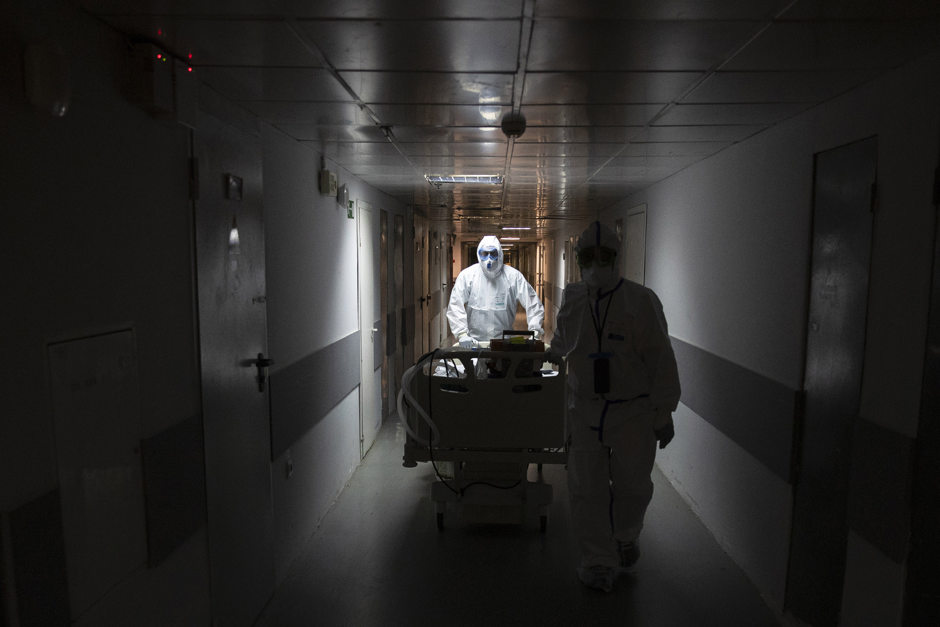 Medical workers move a coronavirus patient at the Filatov City Clinical Hospital in Moscow, Russia, Friday, May 15.