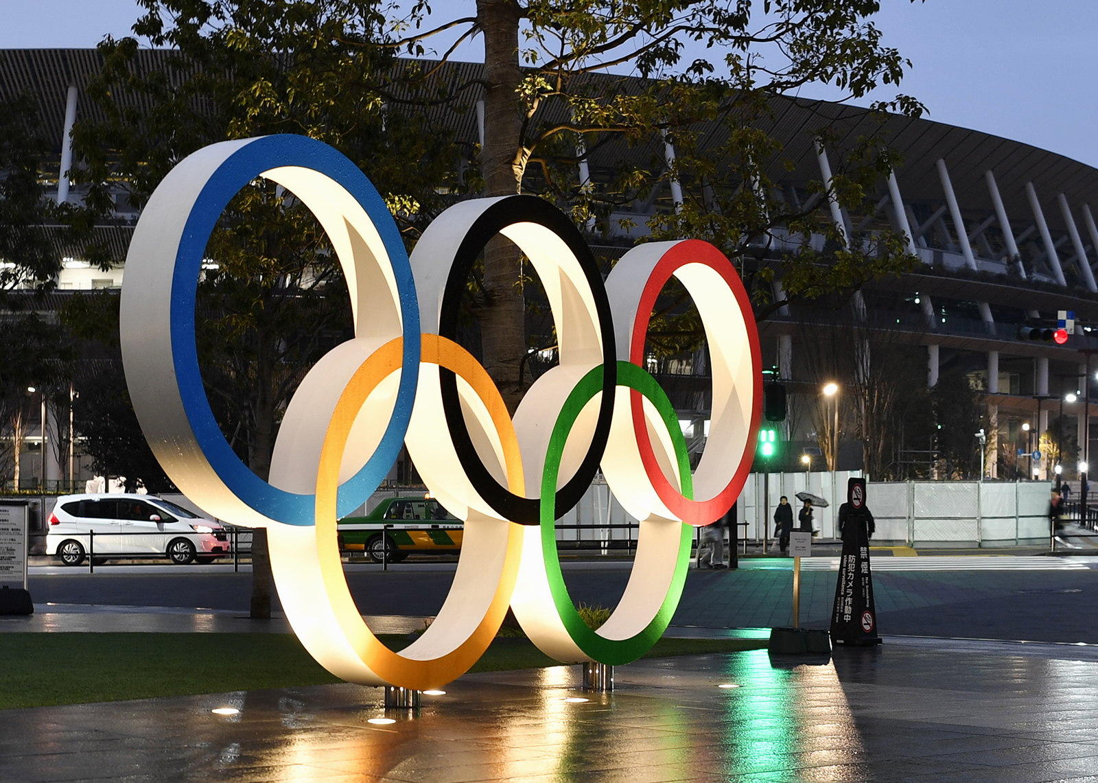 A monument depicting the Olympic rings is seen in front of Tokyo's National Stadium, the main venue for the Olympics and Paralympics, in January 2020.