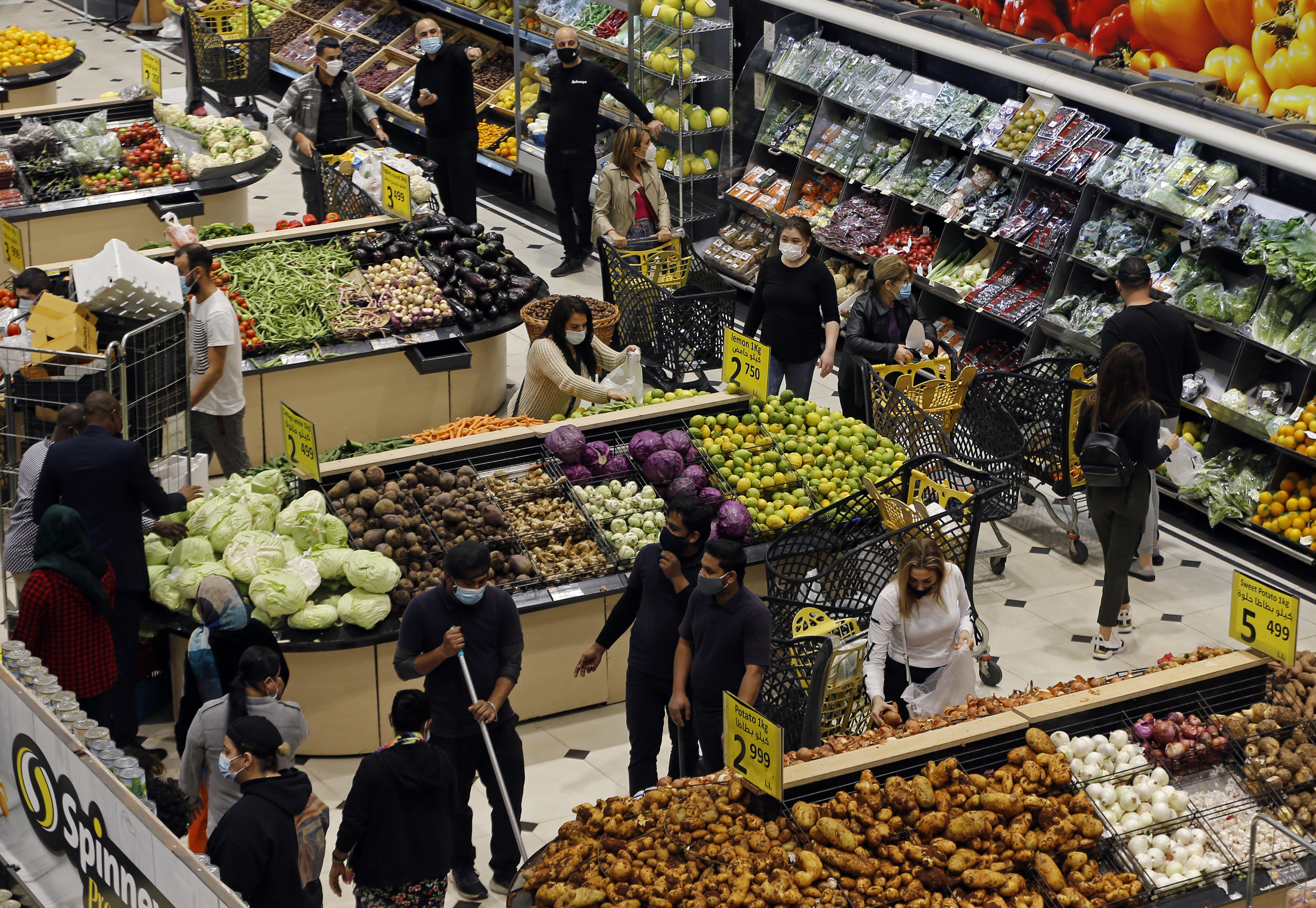 People shop at a supermarket as they stock up on provisions ahead of tighter lockdown restrictions, in Beirut, Lebanon on January 11.