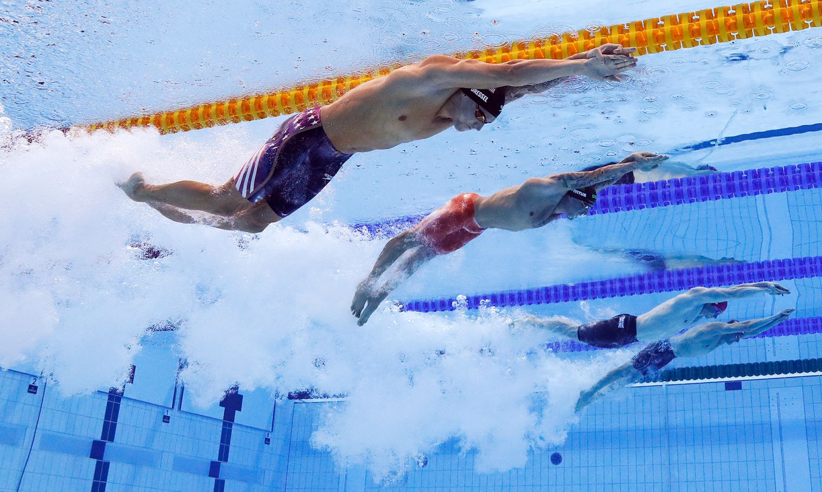 From left, the US' Caeleb Dressel, Brazil's Bruno Fratus, Great Britain's Benjamin Proud and Italy's Lorenzo Zazzeri swim the 50-meter freestyle final on Sunday, August 1.Dressel went on to winwith an Olympic record time of 21.07 seconds.